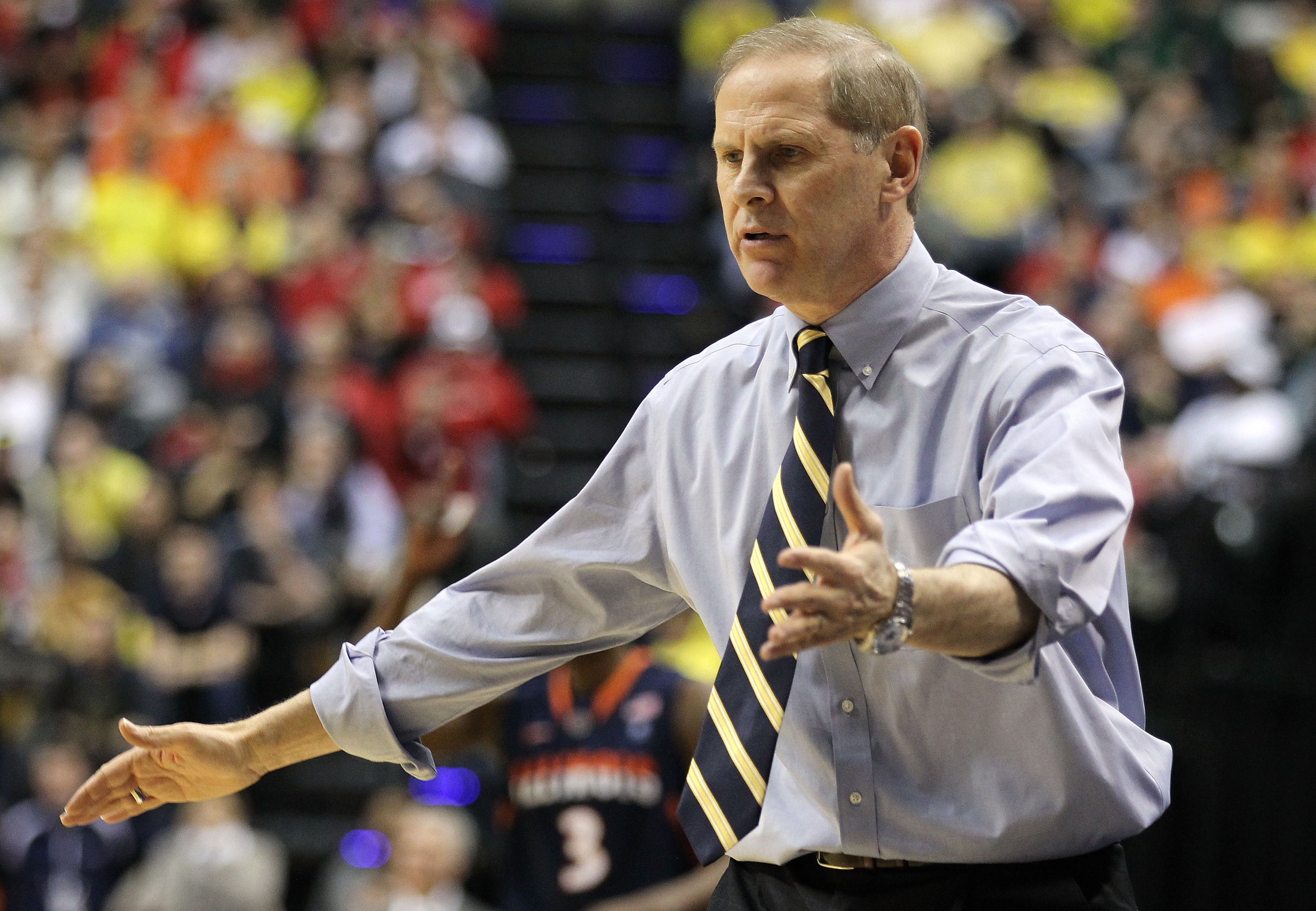 INDIANAPOLIS, IN - MARCH 11:  Head coach John Beilein of the Michigan Wolverines reacts against the Illinois Fighting Illini during the quarterfinals of the 2011 Big Ten Men's Basketball Tournament at Conseco Fieldhouse on March 11, 2011 in Indianapolis,