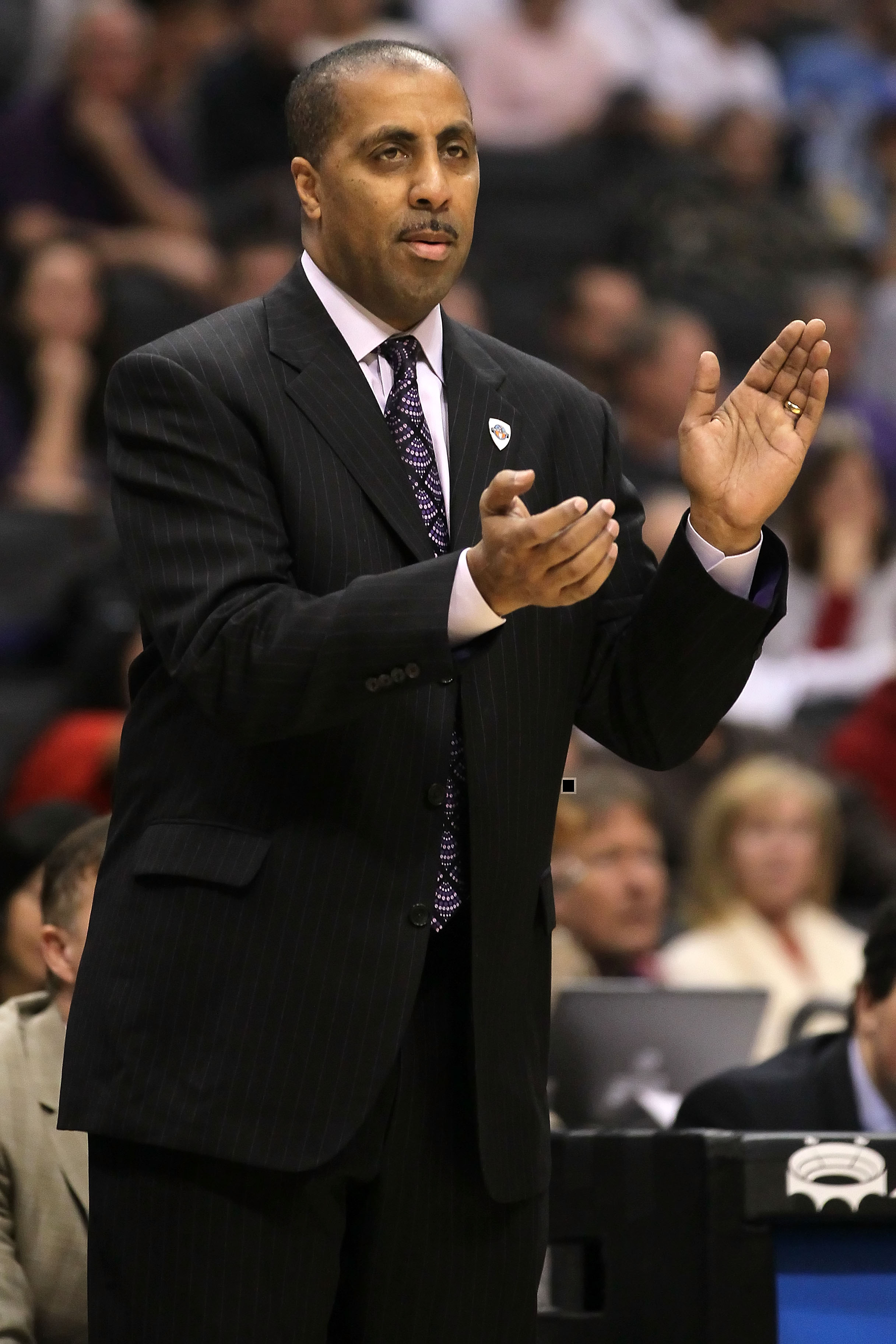 LOS ANGELES, CA - MARCH 12:  Head coach Lorenzo Romar of the Washington Huskies reacts while taking on the Arizona Wildcats in the championship game of the 2011 Pacific Life Pac-10 Men's Basketball Tournament at Staples Center on March 12, 2011 in Los Ang