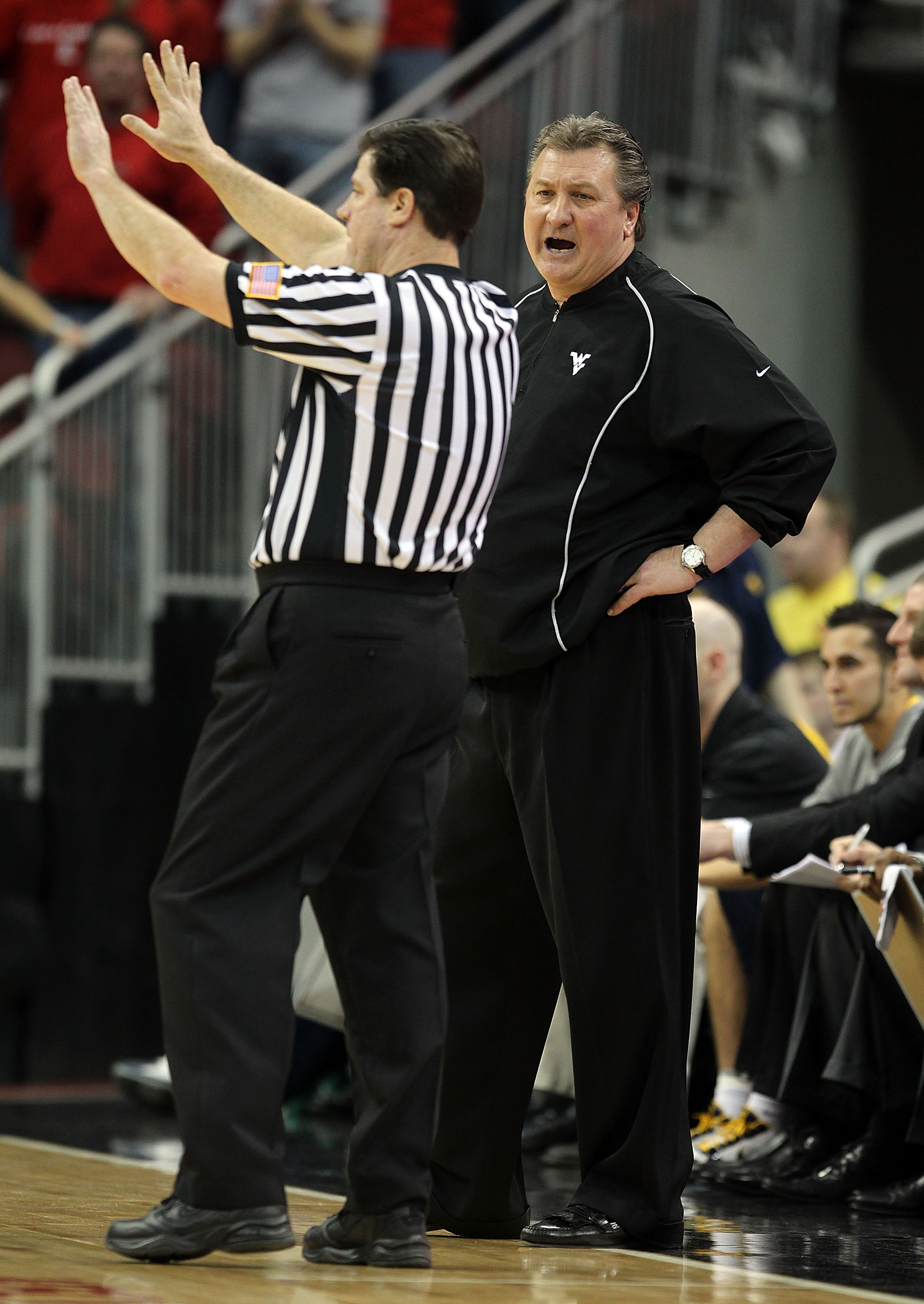 LOUISVILLE, KY - JANUARY 26:  Bob Huggins the Head Coach of the West Virginia Mountaineers yells at a game offical during the Big East Conference game against the Louisville Cardinals at the KFC Yum! Center on January 26, 2011 in Louisville, Kentucky.  Lo