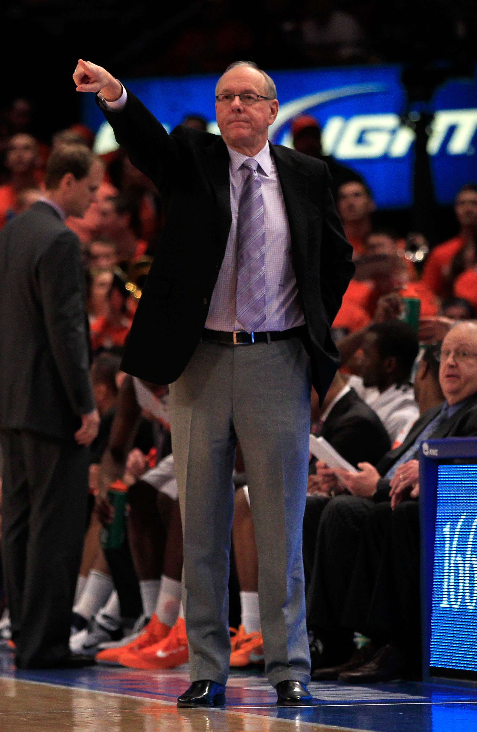 NEW YORK, NY - MARCH 11: Head coach Jim Boeheim of the Syracuse Orange gestures from the bench during the game against the Connecticut Huskies during the semifinals of the 2011 Big East Men's Basketball Tournament presented by American Eagle Outfitters at