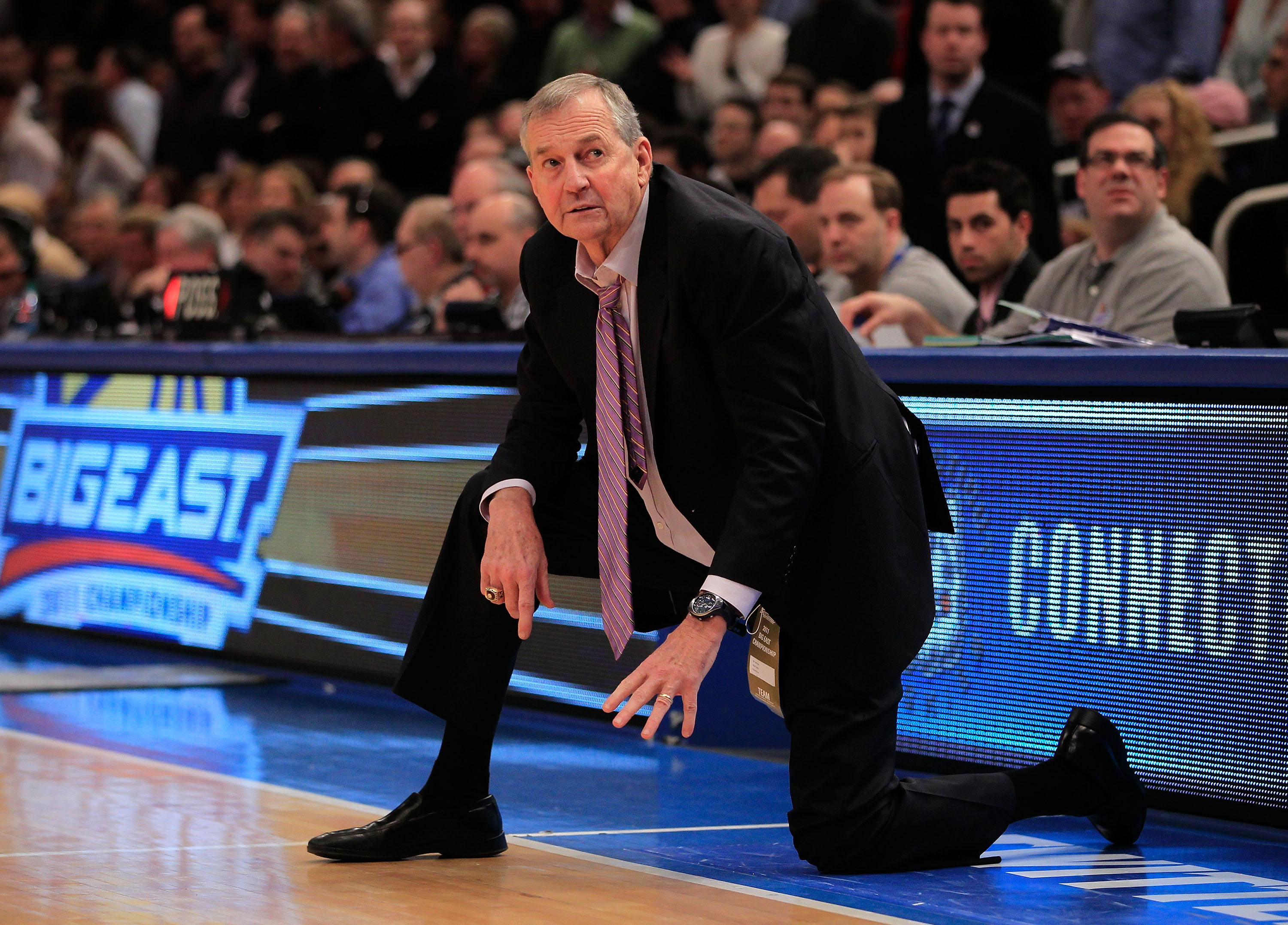 NEW YORK, NY - MARCH 12: Head coach Jim Calhoun of the Connecticut Huskies looks on from the bench late in the game against the Louisville Cardinals during the championship of the 2011 Big East Men's Basketball Tournament presented by American Eagle Outfi
