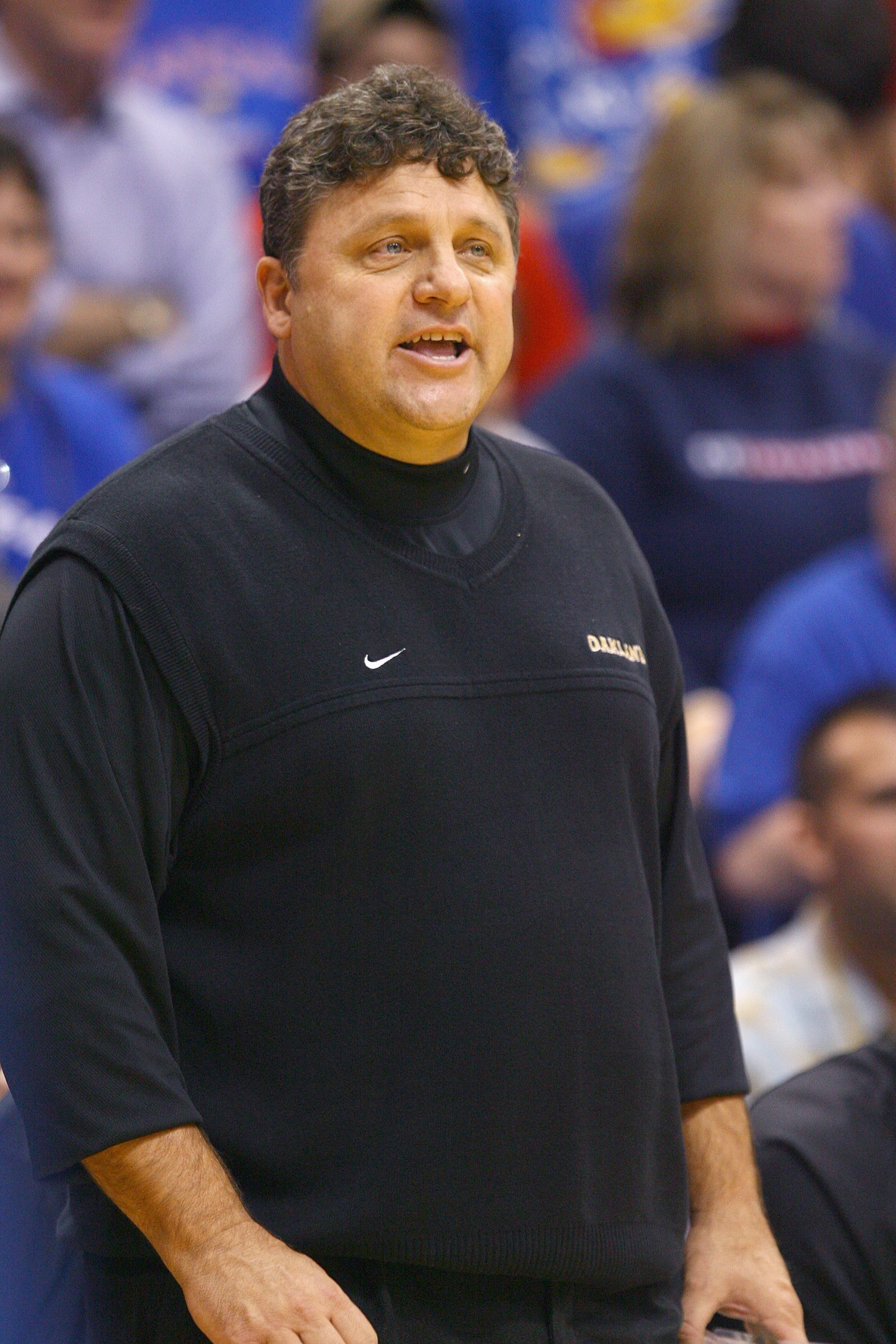 LAWRENCE, KS - NOVEMBER 25:  Head coach Greg Kampeof the Oakland Golden Grizzlies watches the action against the Kansas Jayhawks on November 25, 2009 at Allen Fieldhouse in Lawrence, Kansas. (Photo by Jamie Squire/Getty Images)