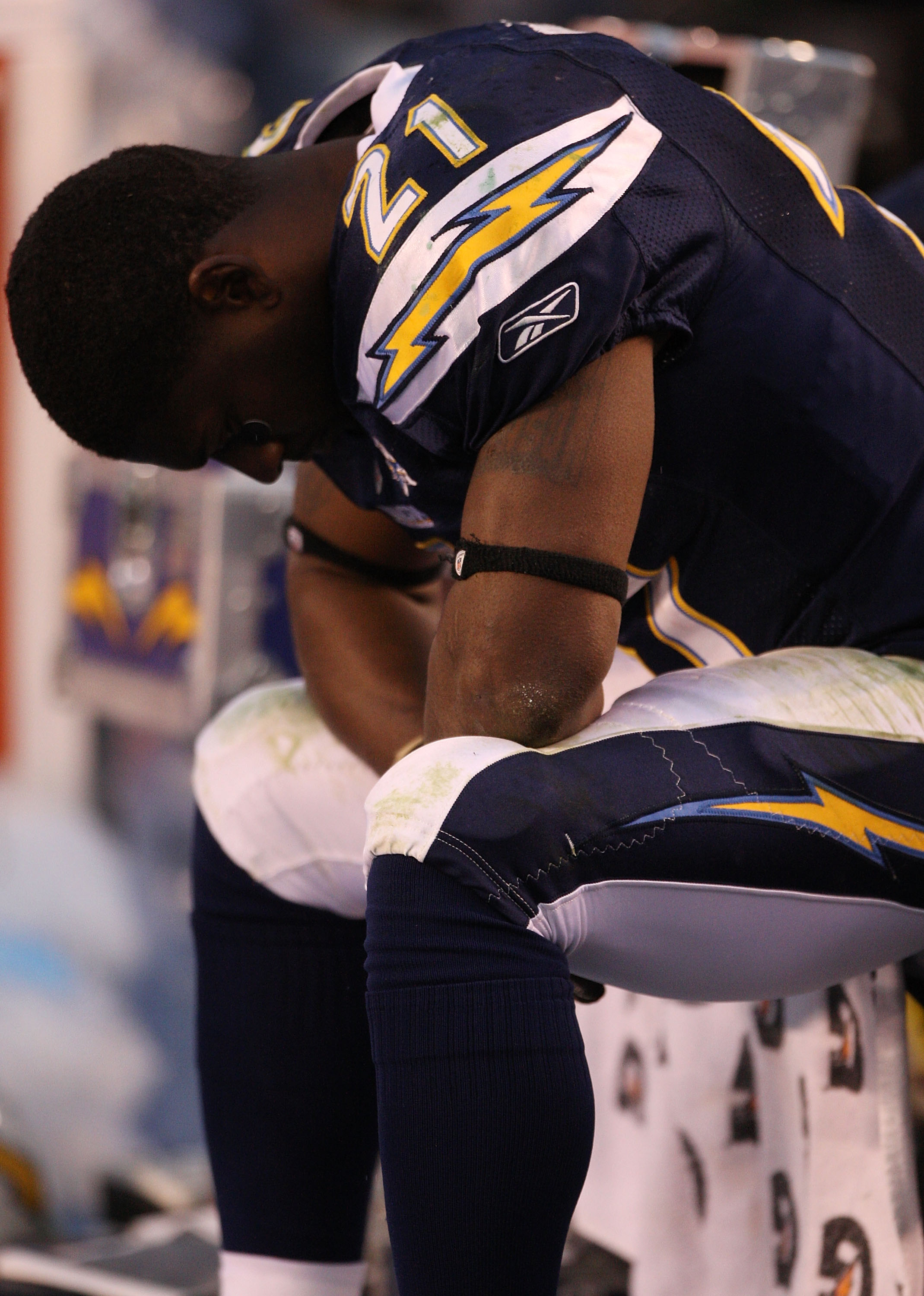 SAN DIEGO - JANUARY 17:  Running back LaDainian Tomlinson #21 of the San Diego Chargers sits on the bench in the final moments of the AFC Divisional Playoff Game against the New York Jets at Qualcomm Stadium on January 17, 2010 in San Diego, California. T