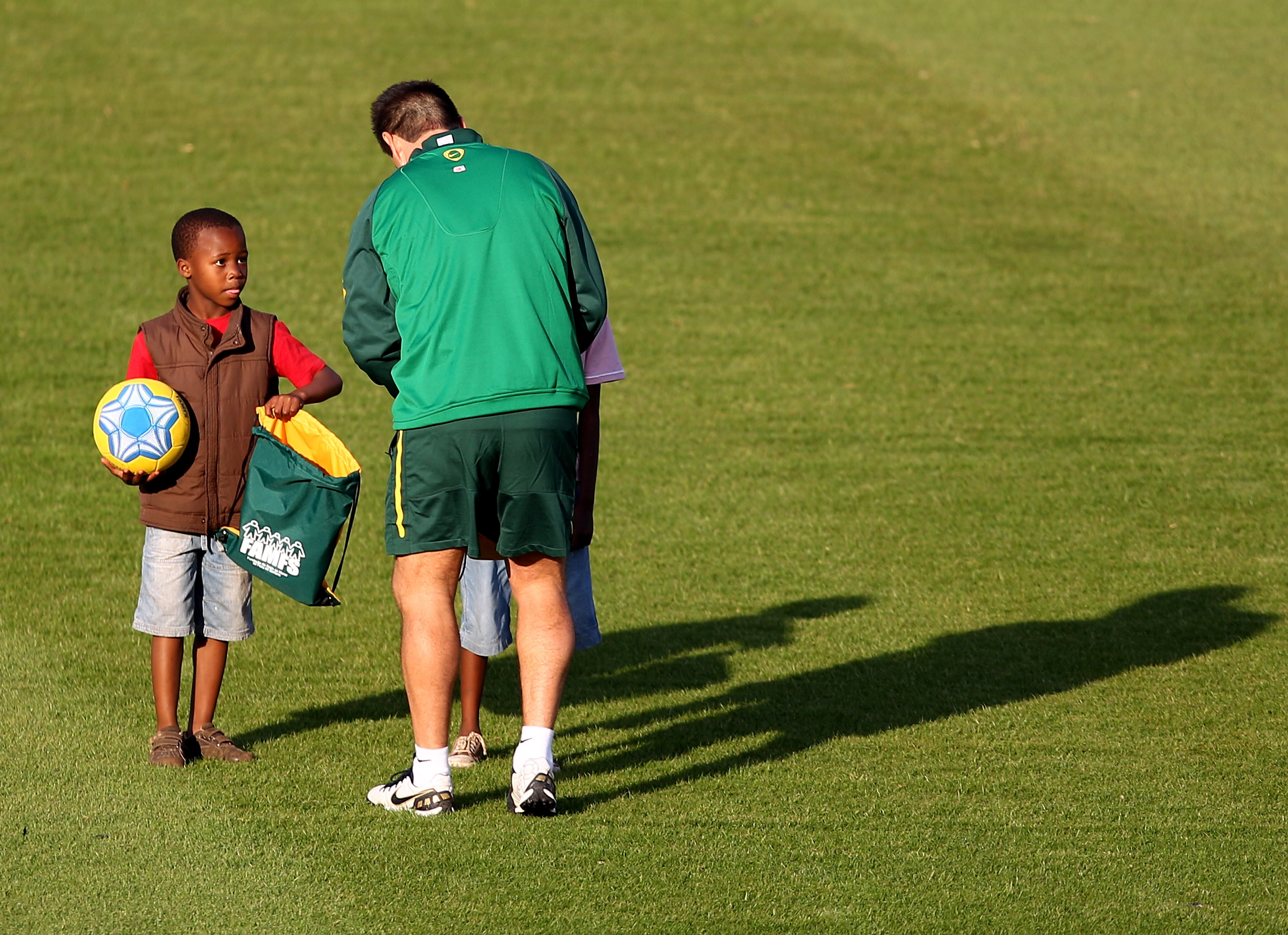 JOHANNESBURG, SOUTH AFRICA - JUNE 03: Head Coach Dunga gives presents to local children during the Brazil Training session at Dobsonville Stadium in Soweto on June 3, 2010 in Johannesburg, South Africa. The Brazil national team are in South Africa to cont