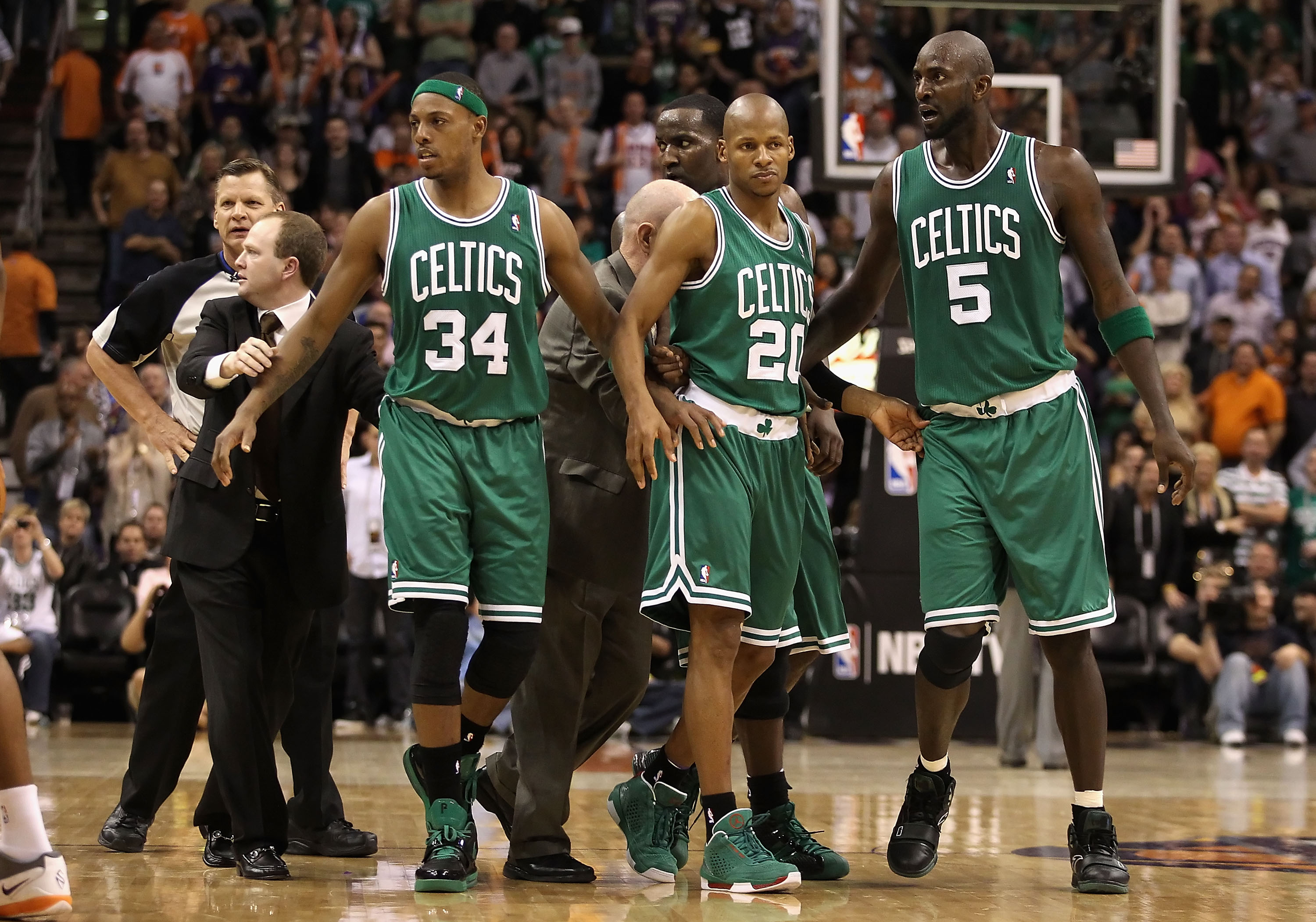 PHOENIX, AZ - JANUARY 28:  Assistant coach Lawrence Frank of the Boston Celtics walks Paul Pierce #34, Ray Allen #20 and Kevin Garnett #5 back to the bench after an altercation against the Phoenix Suns during the NBA game at US Airways Center on January 2
