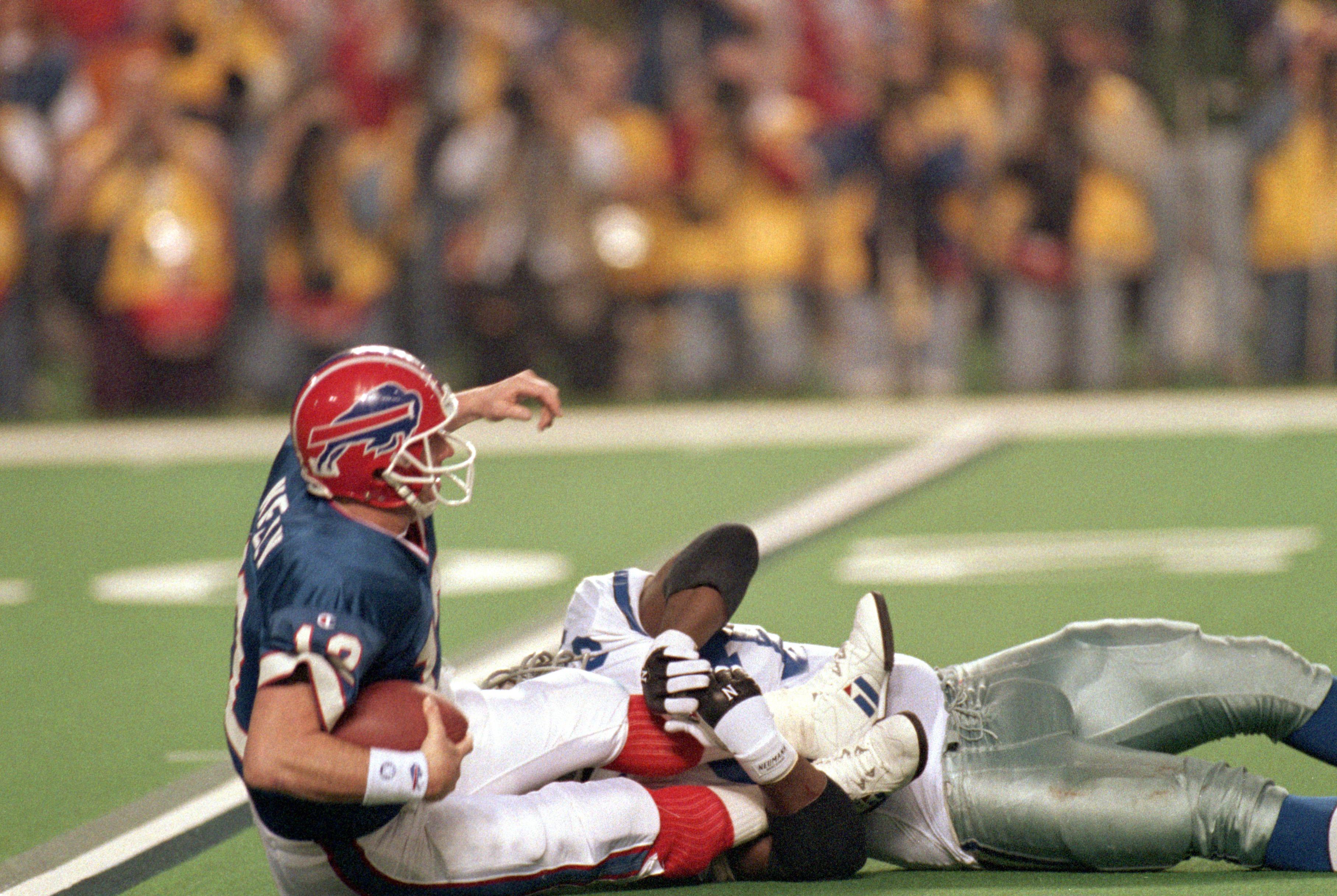 ATLANTA  - JANUARY 30:  Defensive tackle Jimmie Jones #97 of the Dallas Cowboys sacks quarterback Jim Kelly #12 of the Buffalo Bills during Super Bowl XXVIII against the Dallas Cowboys at the Georgia Dome on January 30, 1994 in Atlanta, Georgia.  Kelly co