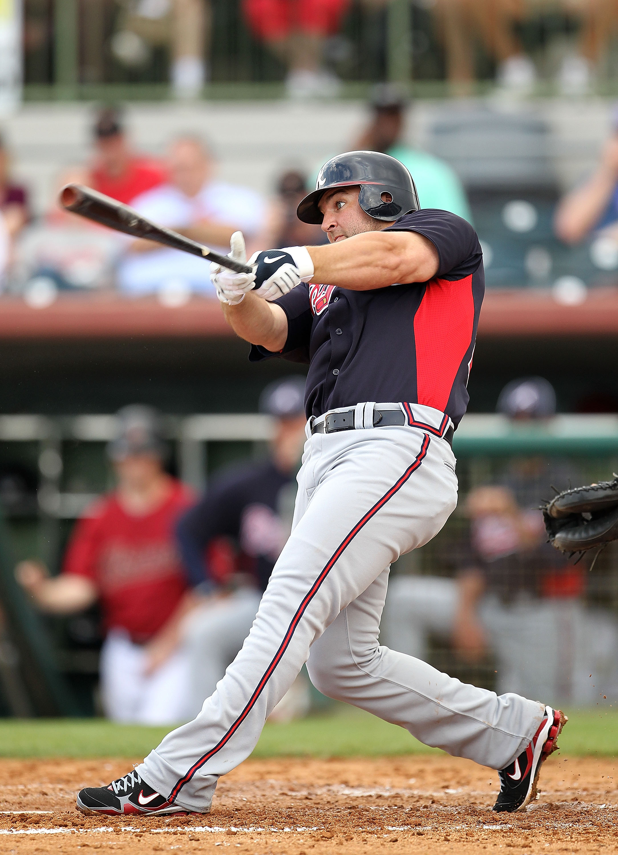 KISSIMMEE, FL - MARCH 01:  Dan Uggla #26 of the Atlanta Braves bats  during a Spring Training game against the Houston Astros at Osceola County Stadium on March 1, 2011 in Kissimmee, Florida.  (Photo by Mike Ehrmann/Getty Images)