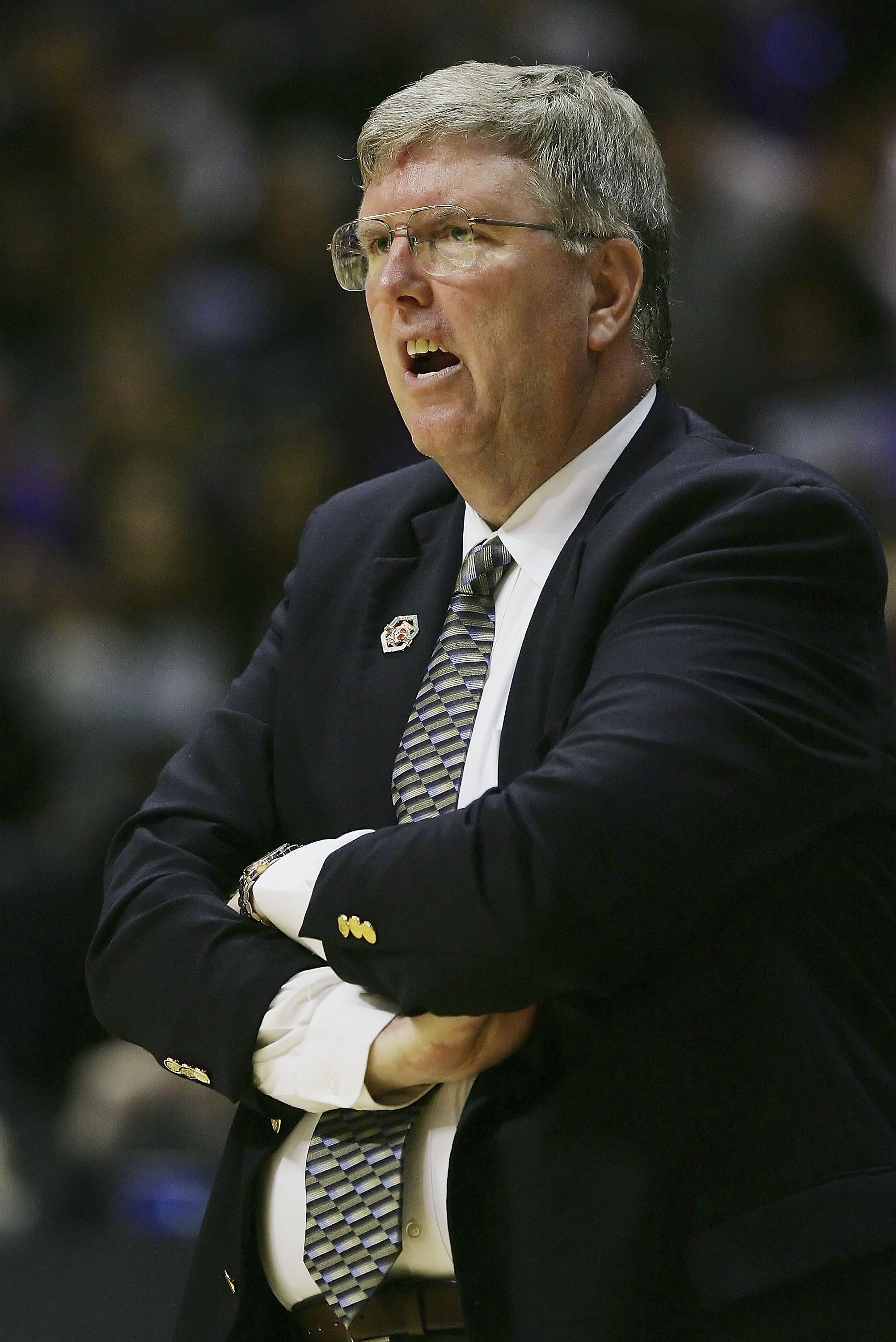 SAN DIEGO - MARCH 16:  Head Coach Stew Morrill of the Utah State Aggies reacts to a play during the game against the Washington Huskies at the first round of the NCAA Finals on March 16, 2006 at Cox Arena in San Diego, California.  (Photo by Lisa Blumenfe