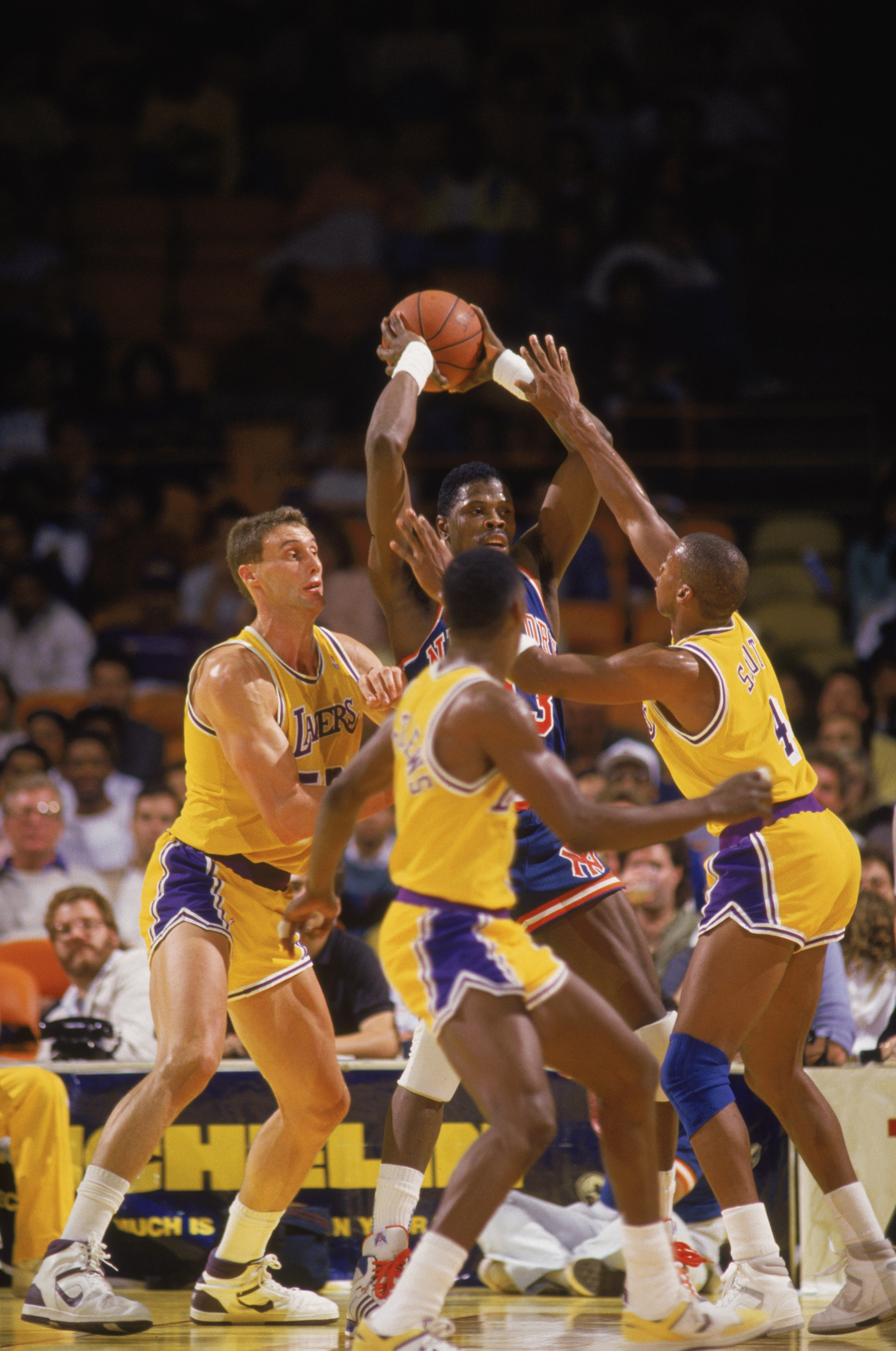 LOS ANGELES - 1987:  Patrick Ewing #33 of the New York Knicks passes out of a double team during an NBA game against the Los Angeles Lakers at the Great Western Forum in Los Angeles, California in 1987. (Photo by: Mike Powell/Getty Images)