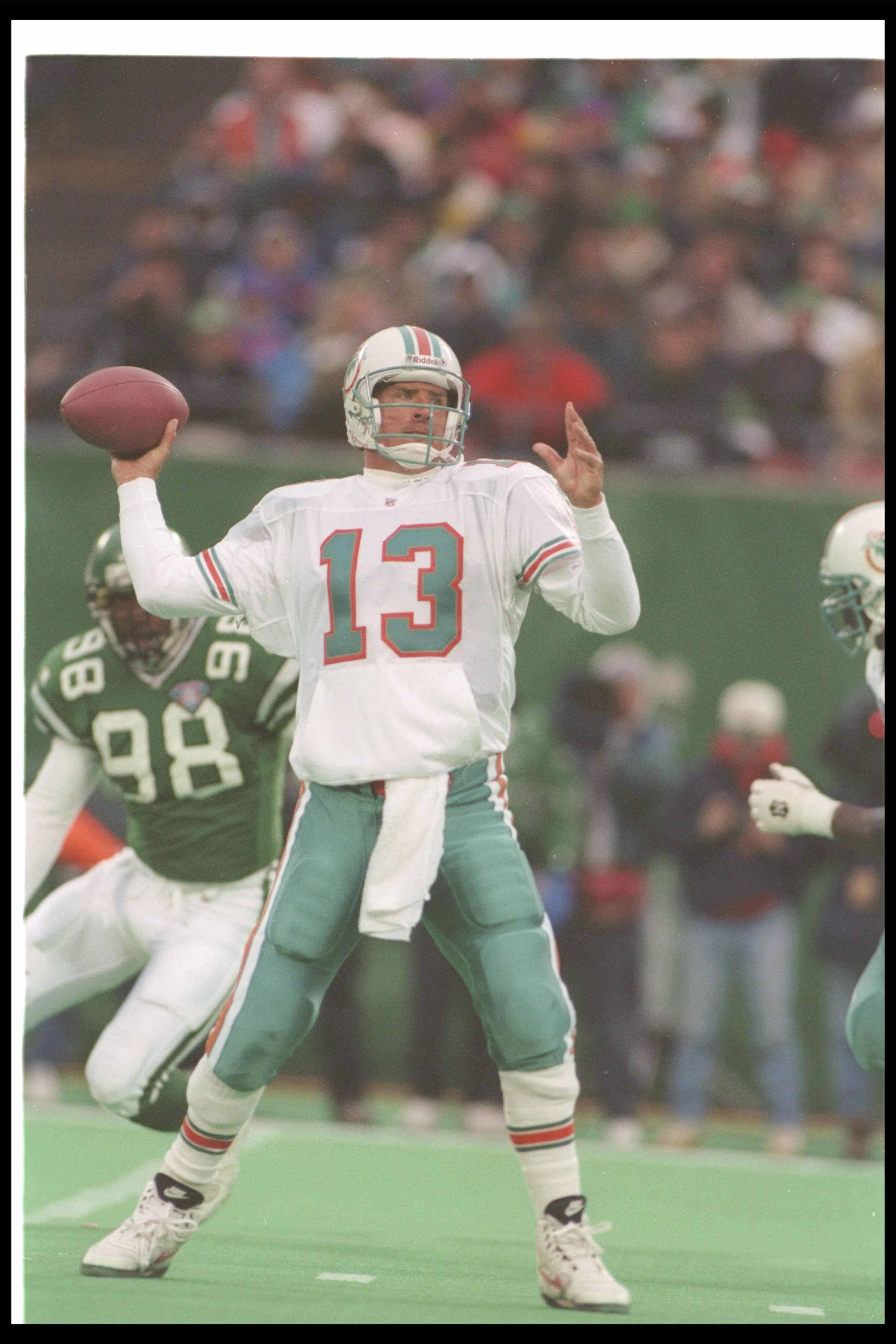 30 Nov 1994:  Quarterback Dan Marino of the Miami Dolphins passes the ball during a game against the New York Jets at Giants Stadium in East Rutherford, New Jersey.  The Dolphins won the game, 28-24. Mandatory Credit: Simon Bruty  /Allsport