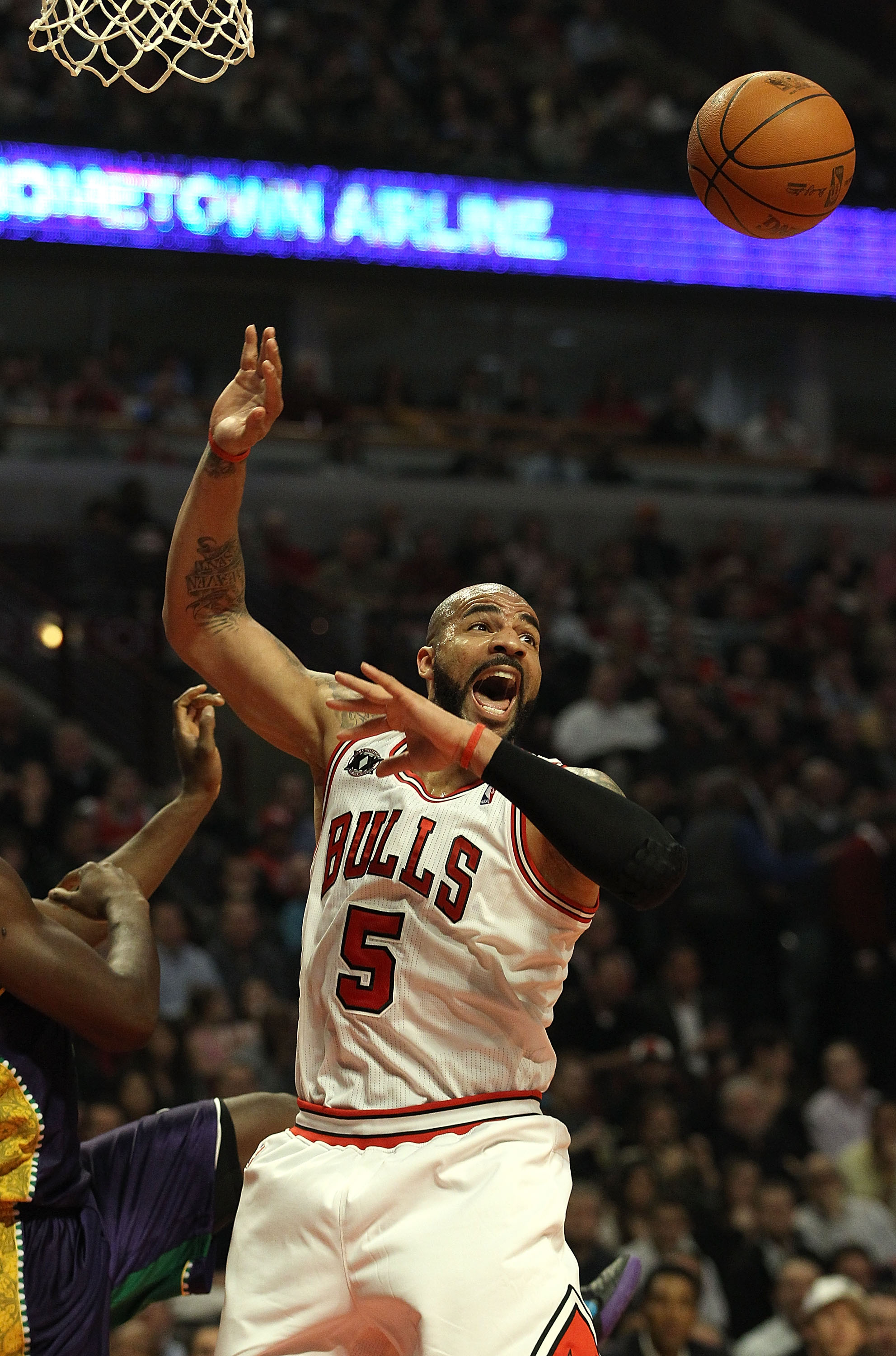 CHICAGO, IL - MARCH 07: Carlos Boozer #5 of the Chicago Bulls looses the ball after grabbing a rebound against the New Orleans Hornets at the United Center on March 7, 2011 in Chicago, Illinois. The Bulls defeated the Hornets 85-77. NOTE TO USER: User exp
