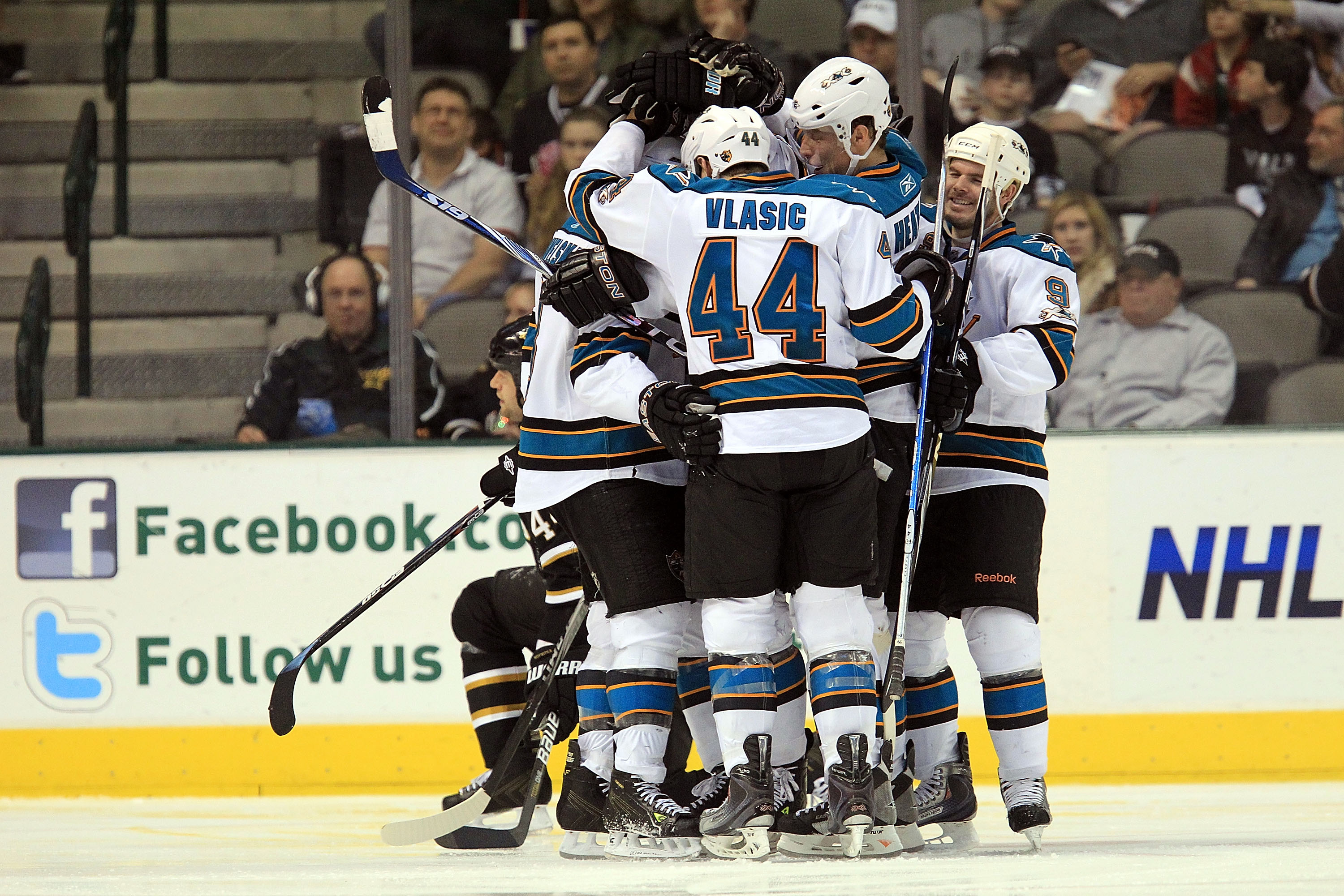 DALLAS, TX - MARCH 15:  The San Jose Sharks celebrate a goal against the Dallas Stars at American Airlines Center on March 15, 2011 in Dallas, Texas.  (Photo by Ronald Martinez/Getty Images)