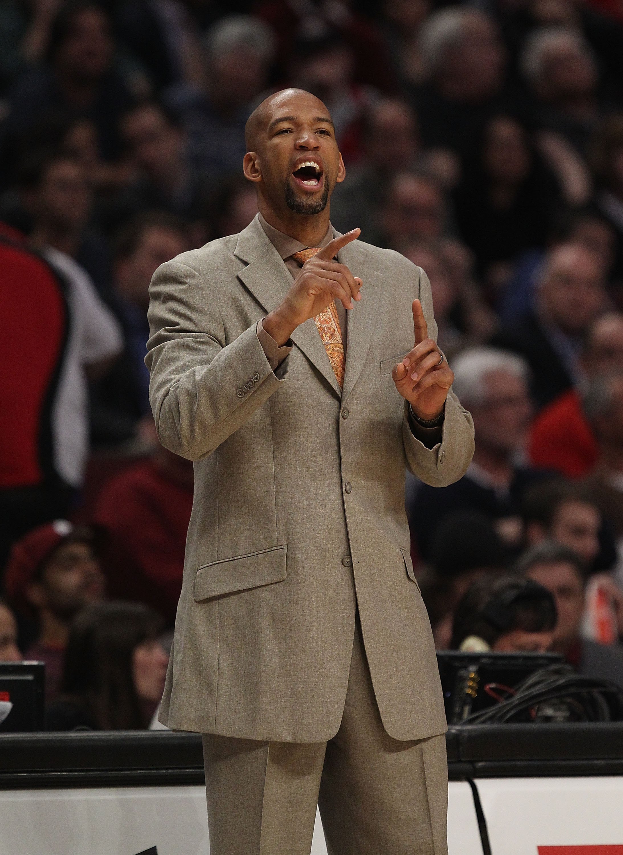 CHICAGO, IL - MARCH 07: Head coach Monty Williams of the New Orleans Hornets gives instructions to his team against the Chicago Bulls at the United Center on March 7, 2011 in Chicago, Illinois. The Bulls defeated the Hornets 85-77. NOTE TO USER: User expr
