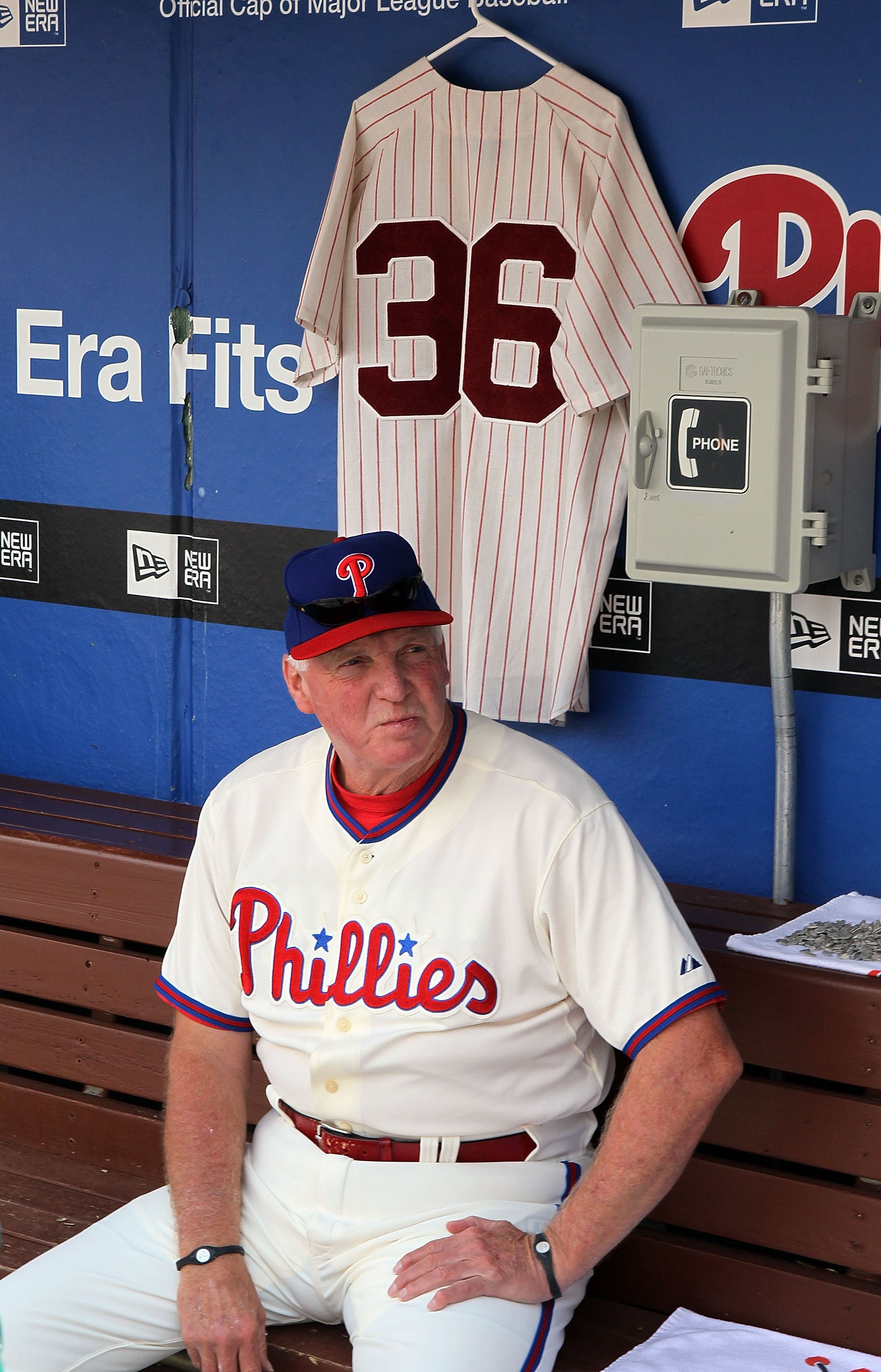 PHILADELPHIA - MAY 06:  Manager Charlie Manuel of the Philadelphia Phillies sits in the dugout next to a jersey of Phillies Hall of Fame pitcher Robin Roberts prior to playing the St. Louis Cardinals at Citizens Bank Park on May 6, 2010 in Philadelphia, P