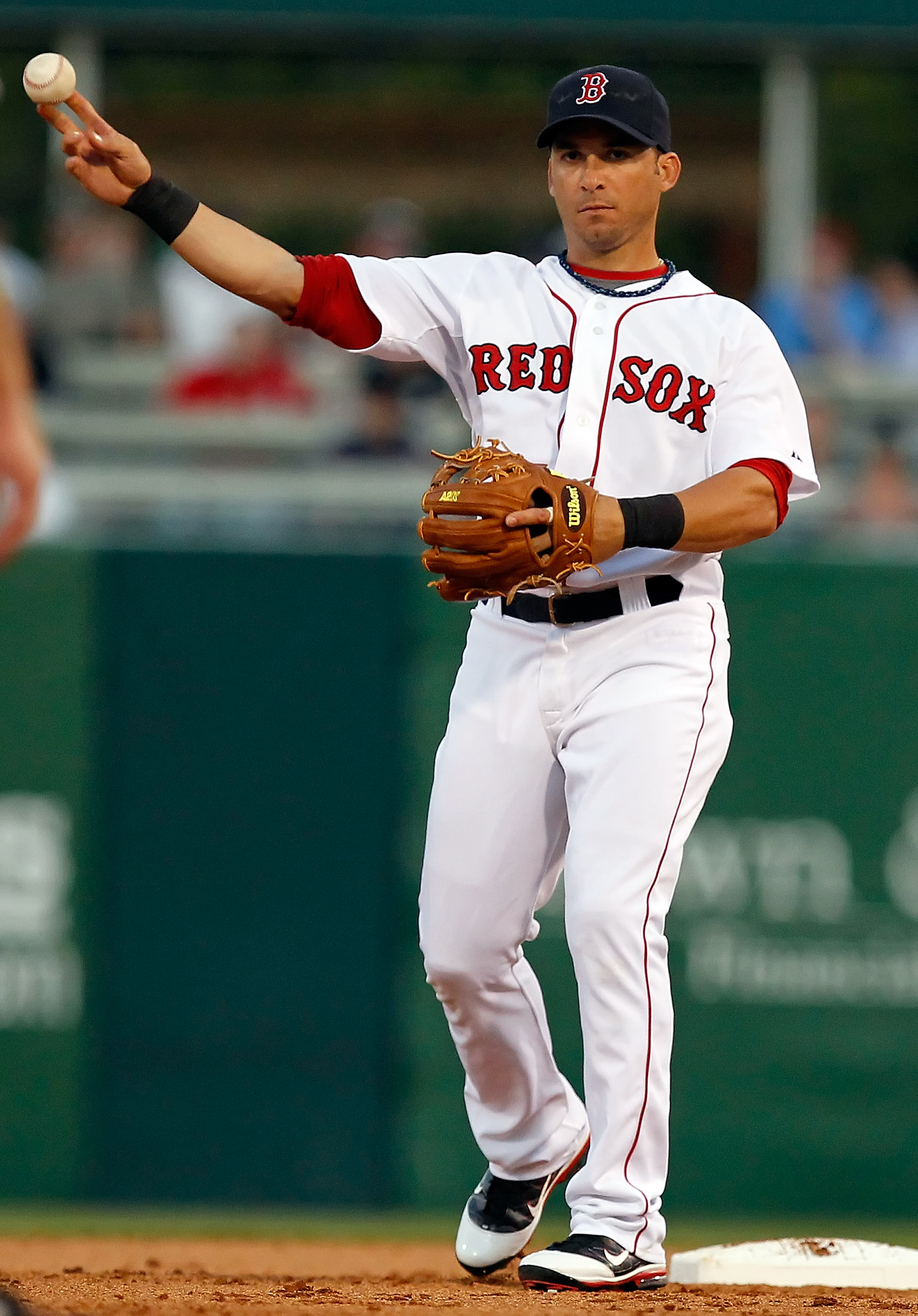 FORT MYERS, FL - MARCH 14:  Shortstop Marco Scutaro #16 of the Boston Red Sox throws the ball against the New York Yankees during a Grapefruit League Spring Training Game at City of Palms Park on March 14, 2011 in Fort Myers, Florida.  (Photo by J. Meric/