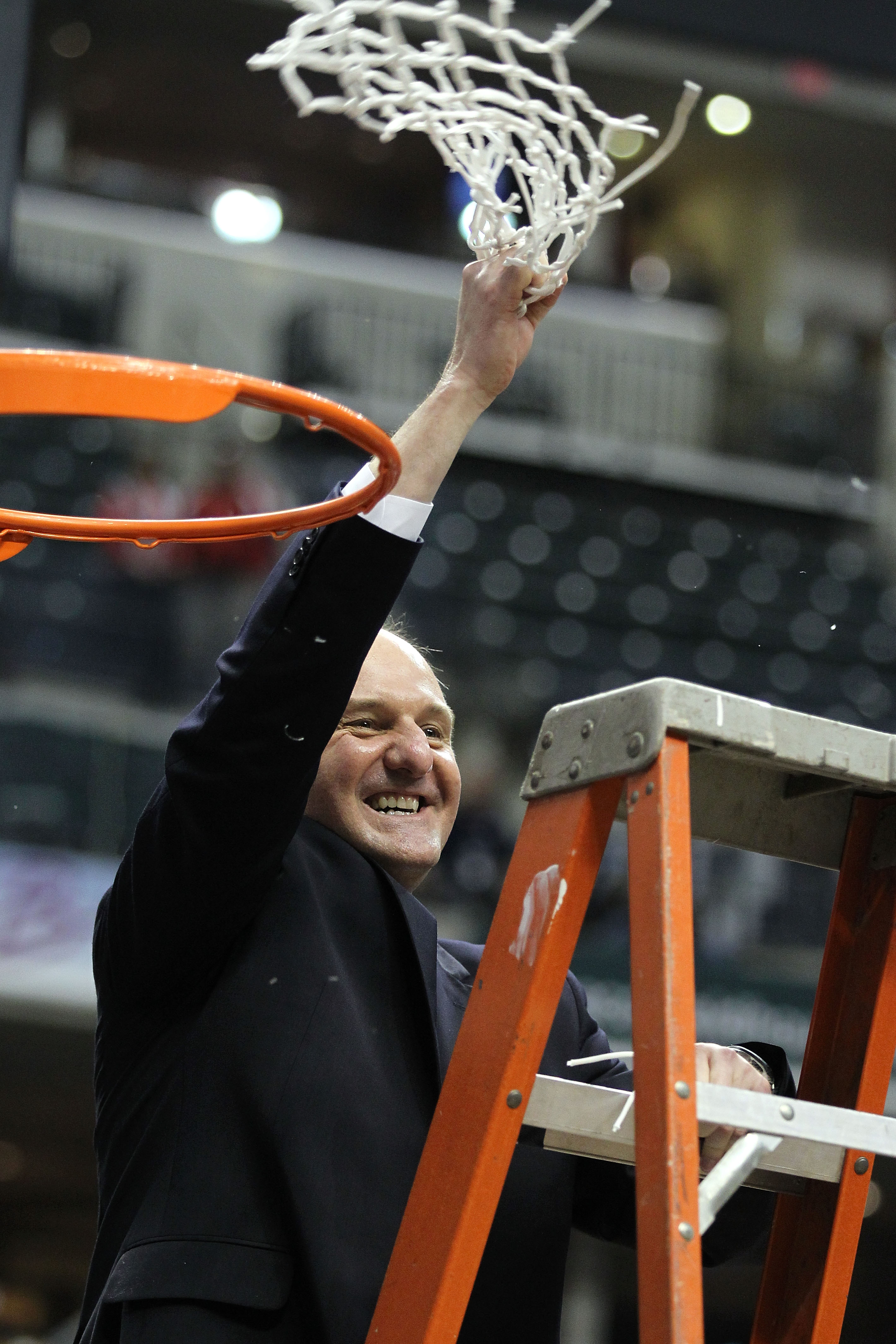 INDIANAPOLIS, IN - MARCH 13:  Head coach Thad Matta of the Ohio State Buckeyes celebrates after he cut down the net following their 71-60 win against the Penn State Nittany Lions during the championship game of the 2011 Big Ten Men's Basketball Tournament
