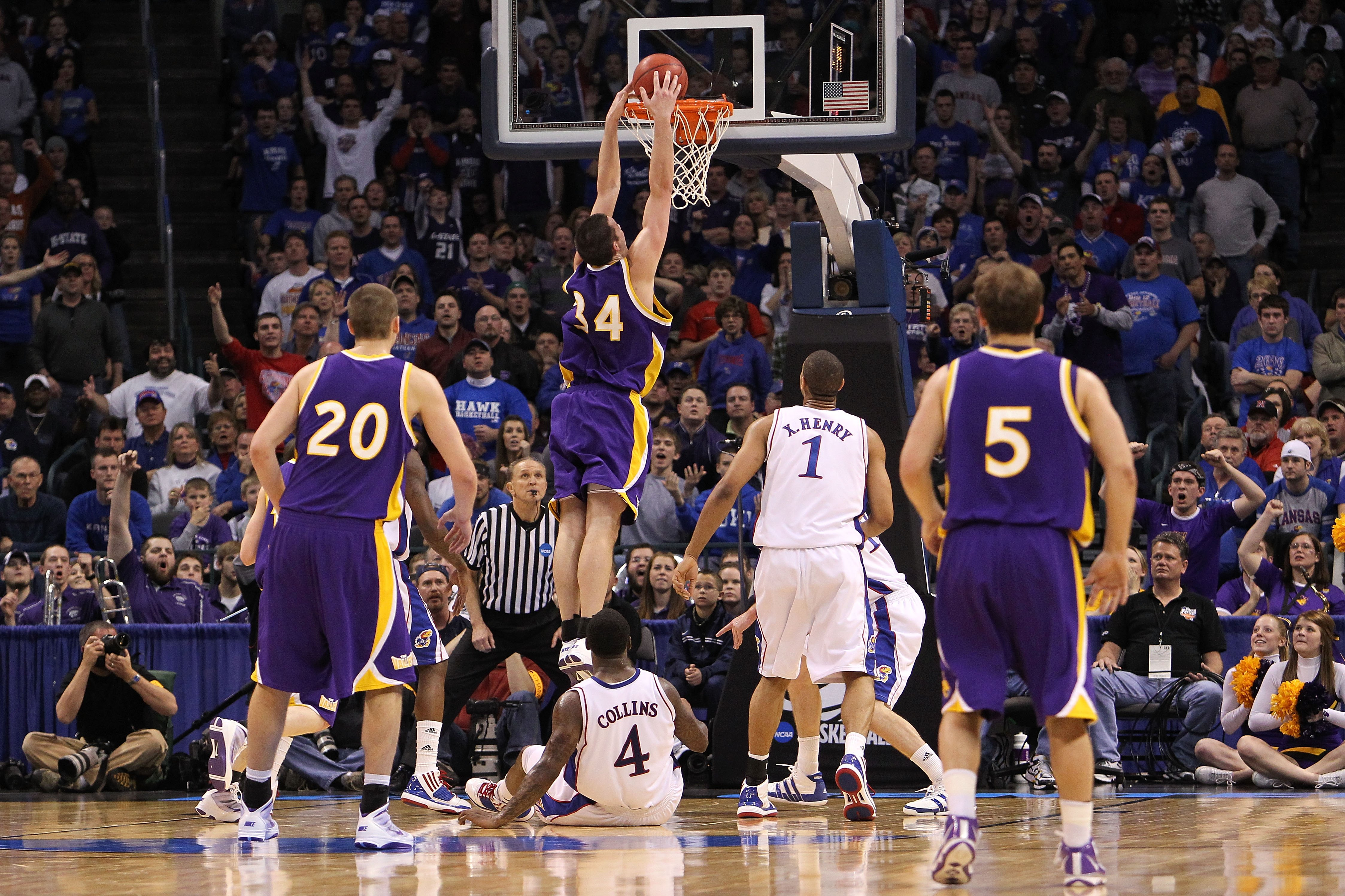 OKLAHOMA CITY - MARCH 20:  Adam Koch #34 the Northern Iowa Panthers dunks against the Kansas Jayhawks during the second round of the 2010 NCAA men's basketball tournament at Ford Center on March 20, 2010 in Oklahoma City, Oklahoma.  (Photo by Ronald Marti