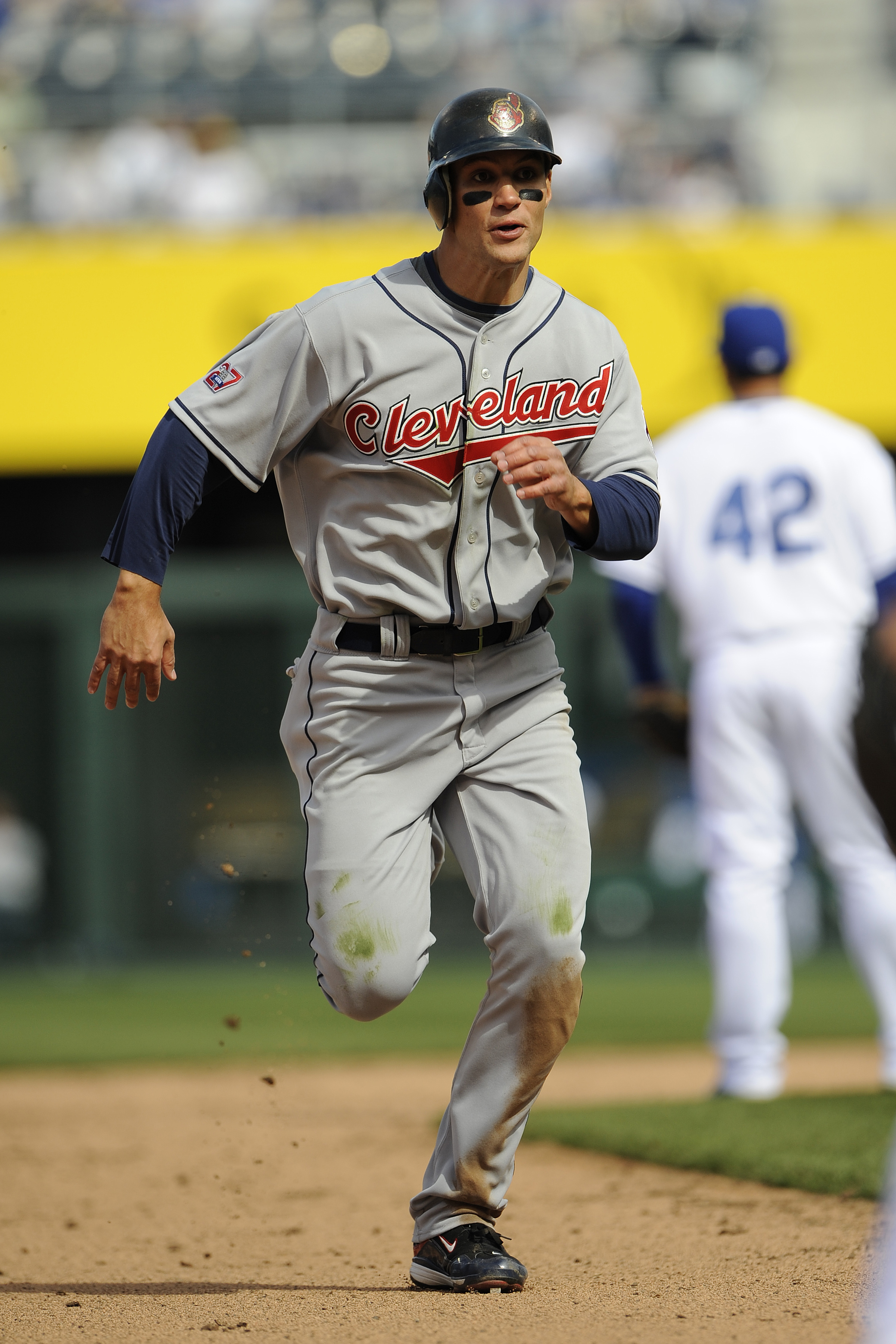 KANSAS CITY, MO - APRIL 15:  Grady Sizemore of the Cleveland Indians, wearing a #42 jersey during the Jackie Robinson Day game runs to third base against the Kansas City Royals on April 15, 2009 at Kauffman Stadium in Kansas City, Missouri.  (Photo by G.