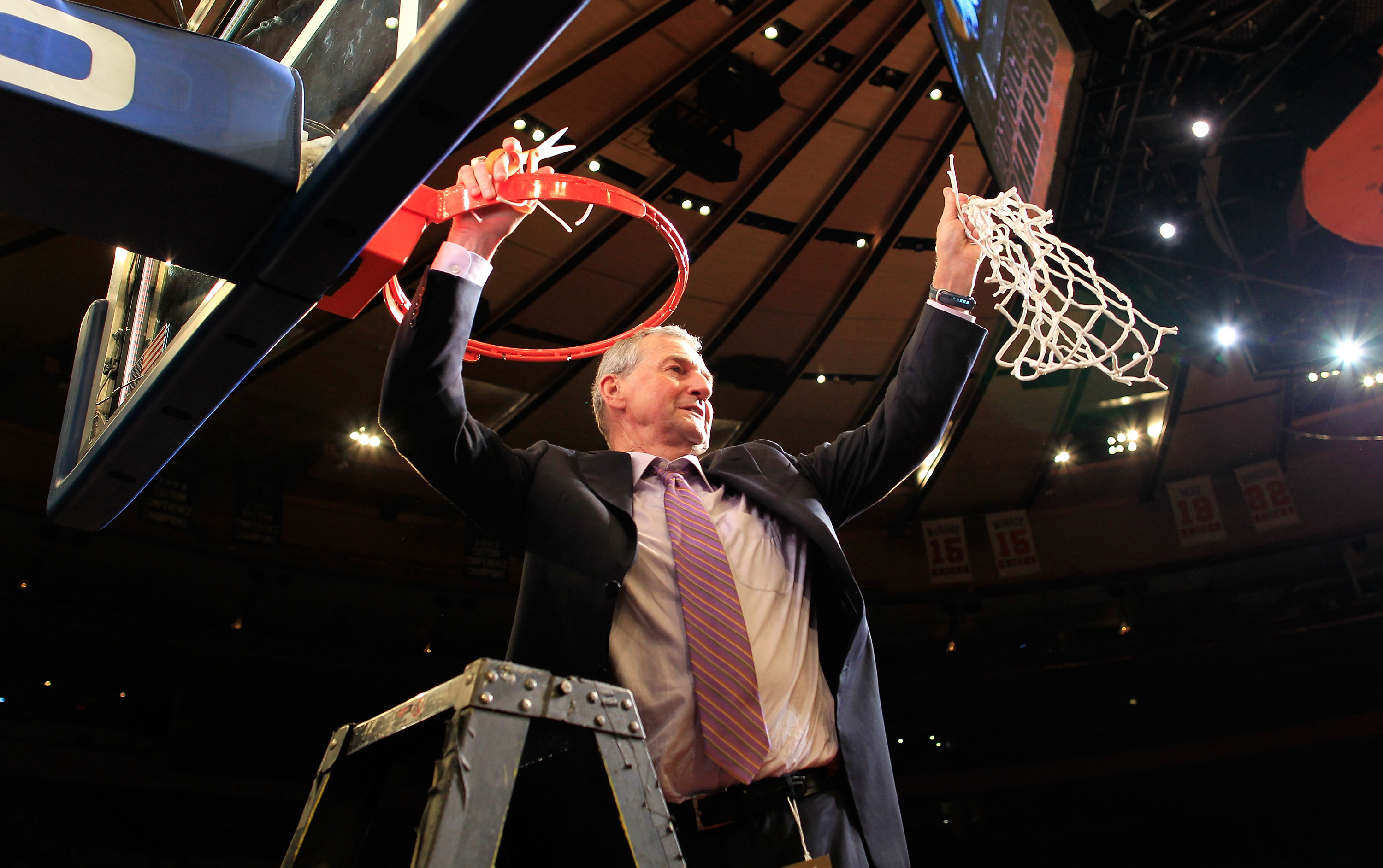 NEW YORK, NY - MARCH 12:  Head coach Jim Calhoun of the Connecticut Huskies cuts down the net after defeating the Louisville Cardinals during the championship of the 2011 Big East Men's Basketball Tournament presented by American Eagle Outfitters at Madis