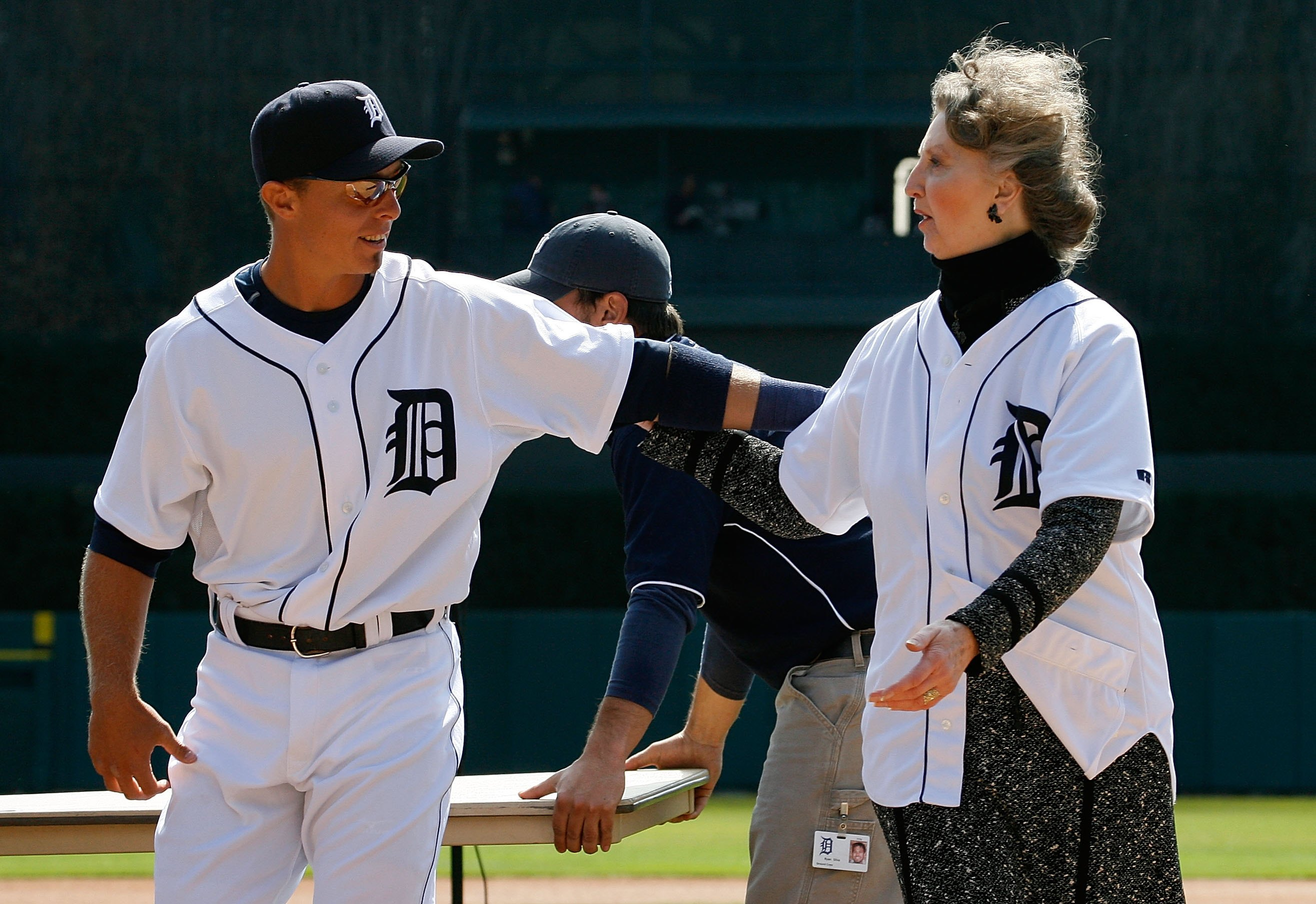 DETROIT - APRIL 02:  Administrative Assistant, Public Affairs Audrey Zielinski (R) and Brandon Inge #15 of the Detroit Tigers walk off the field after they presented a replica of the Tigers 2006 American League Championship Banner for the fans prior to th