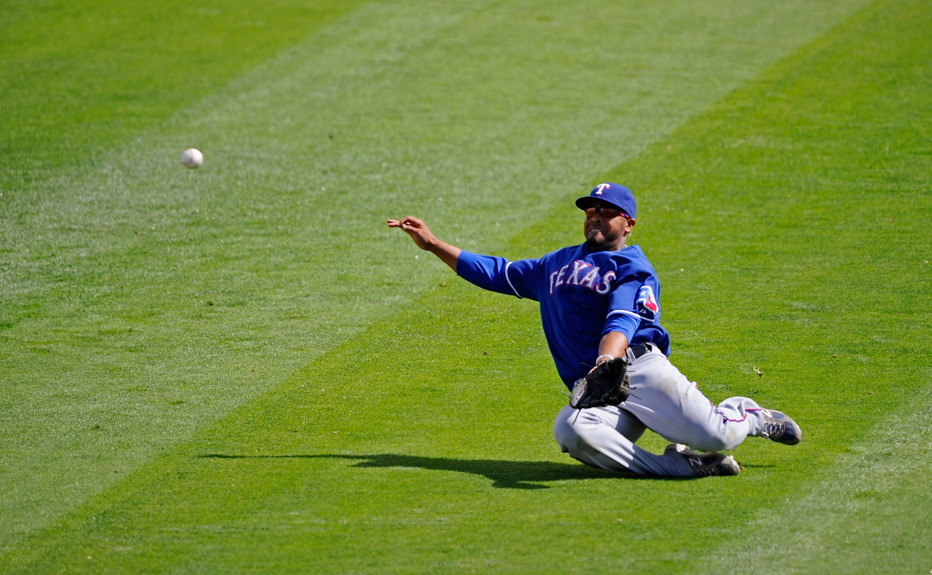 GLENDALE, AZ - MARCH 15:  Nelson Cruz #17 of the Texas Rangers attempts to unsucsessfully make a sliding catch on a  basehit by Andre Ethier #16 of the Los Angeles Dodgers during the thrid inning of the spring training baseball game at Camelback Ranch on