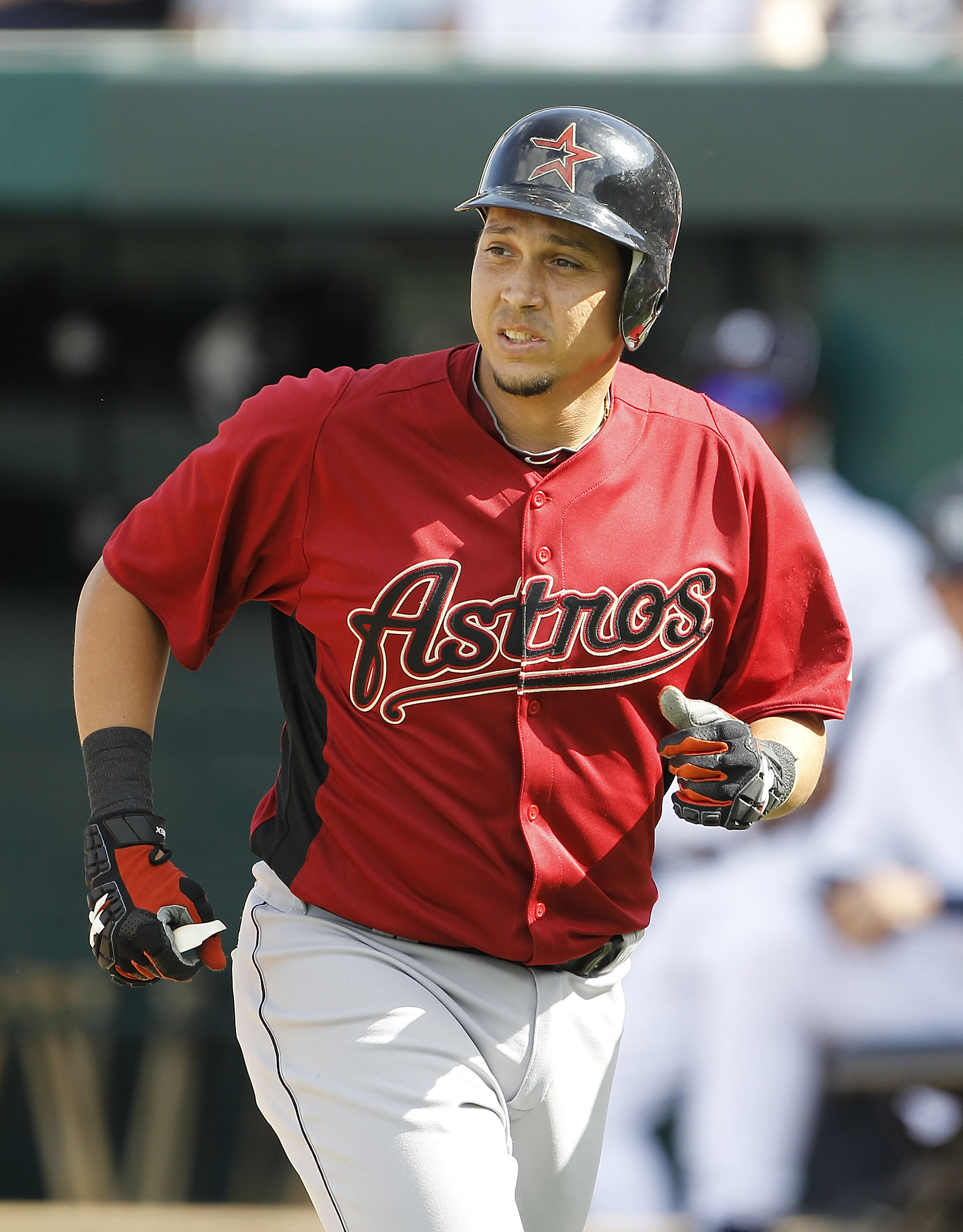 LAKELAND, FL - MARCH 02:  Oswaldo Navarro #26 of the Houston Astros looks to the dugout after hitting an eight inning three run home run during the game against the Detroit Tigers at Joker Marchant Stadium on March 2, 2011 in Lakeland, Florida. The Astros