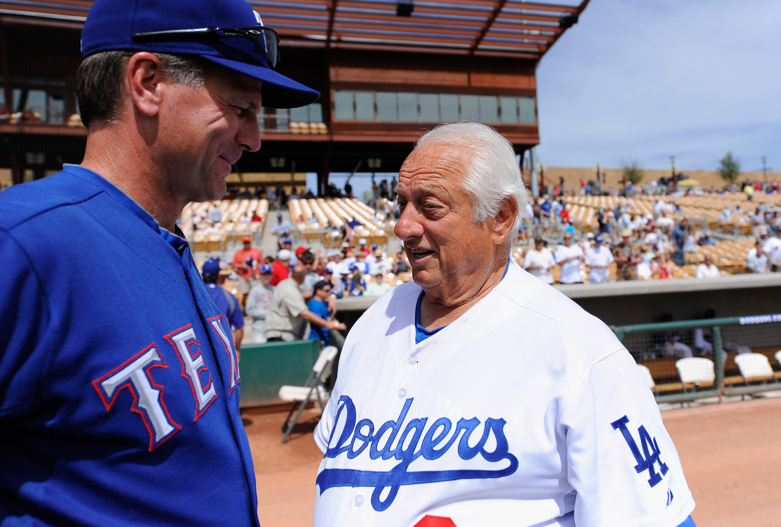 GLENDALE, AZ - MARCH 15:  Hall of Fame manager Tommy Lasorda #2  of the Los Angeles Dodgers visit with coach Dave Anderson #16  of the Texas Rangers during the spring training baseball game at Camelback Ranch on March 15, 2011 in Glendale, Arizona.  (Phot