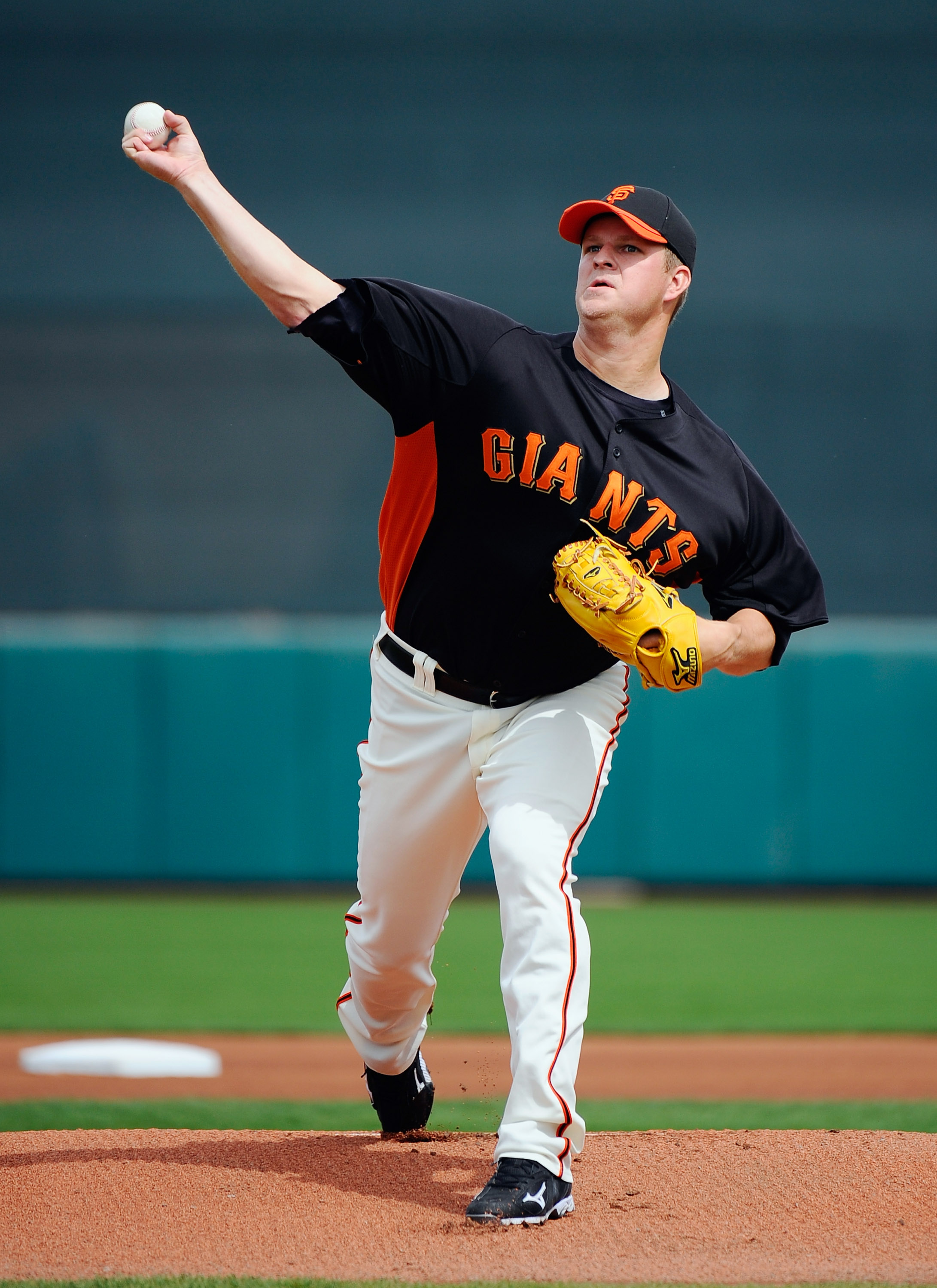 SCOTTSDALE, AZ - MARCH 14:  Matt Cain #18 of the San Francisco Giants throws a pitch against the Milwaukee Brewers during the spring training baseball game at Scottsdale Stadium on March 14, 2011 in Scottsdale, Arizona.  (Photo by Kevork Djansezian/Getty