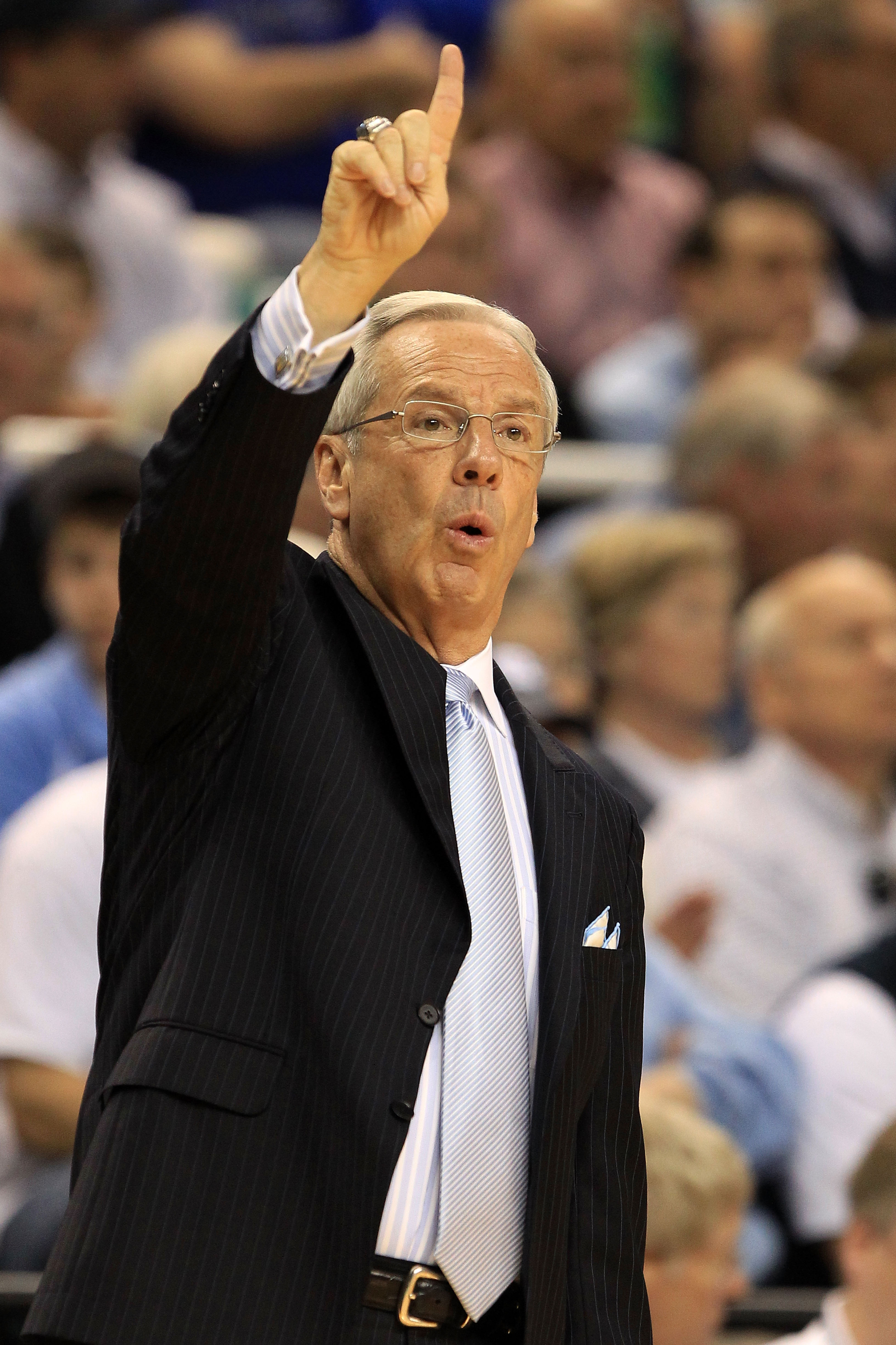 GREENSBORO, NC - MARCH 13:  Head coach Roy Williams of the North Carolina Tar Heels calls a play during the first half of the game against the Duke Blue Devils in the championship game of the 2011 ACC men's basketball tournament at the Greensboro Coliseum