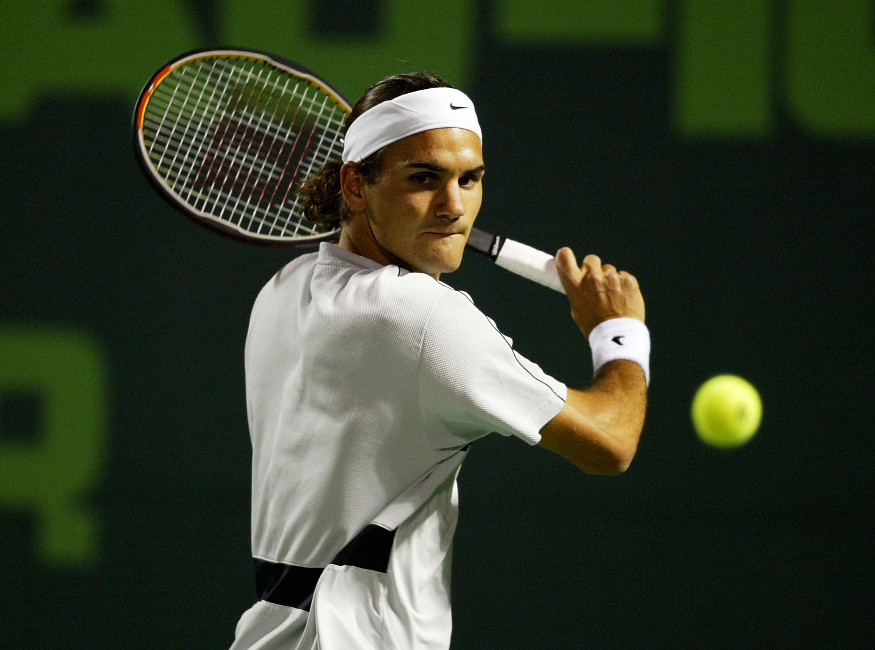 MIAMI - MARCH 28:  Roger Federer of Switzerland returns a shot against Rafael Nadal of Spain on March 28, 2004 during Nasdaq 100 Open  at the Crandon Park Tennis Center on Key Biscayne in Miami, Florida.  (Photo by Ezra Shaw/Getty Images)