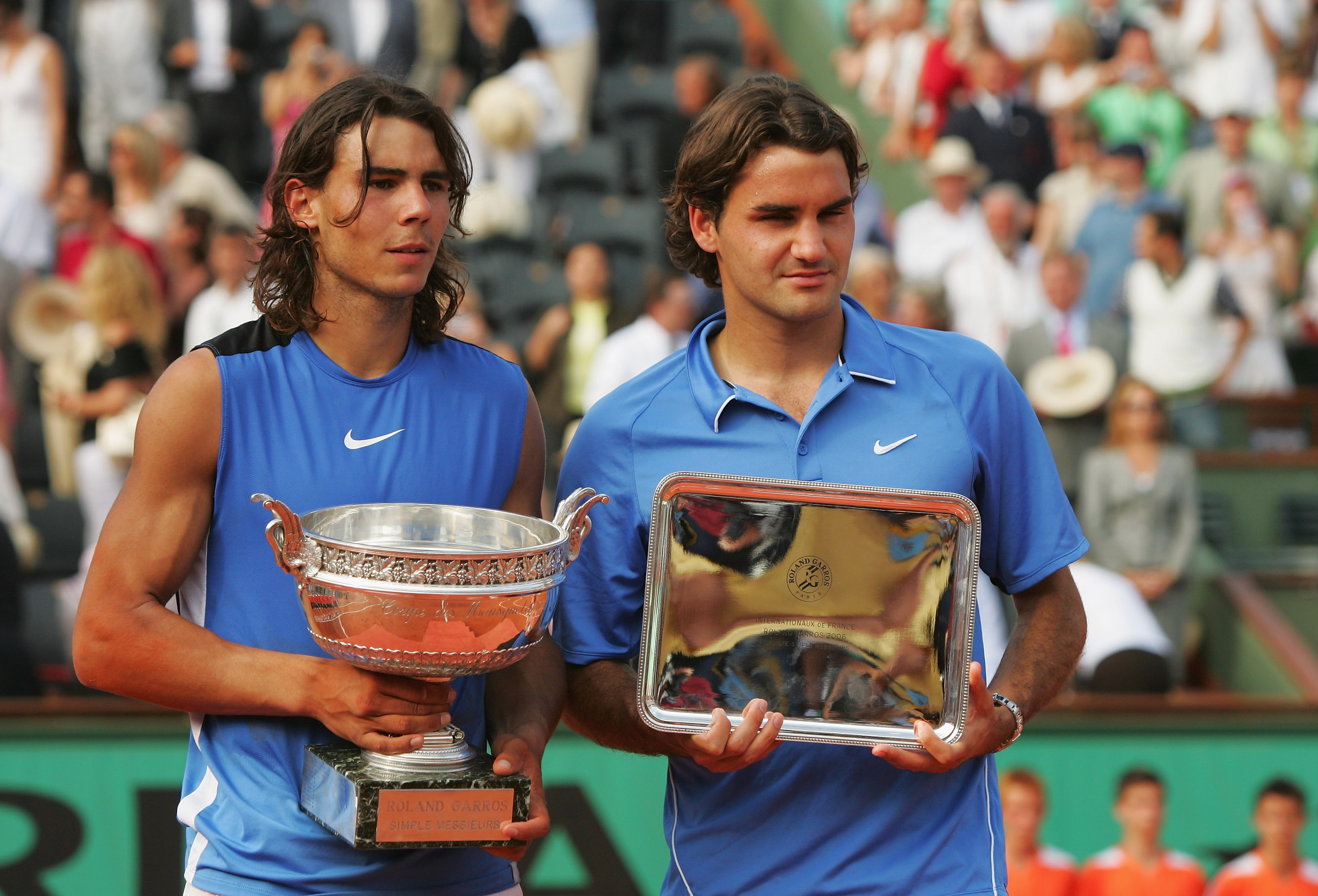 PARIS - JUNE 11:  Rafael Nadal (L) of Spain looks on after defeating Roger Federer (R) of Switzerland during the Men's Singles Final on day fifteen of the French Open at Roland Garros on June 11, 2006 in Paris, France.  (Photo by Matthew Stockman/Getty Im