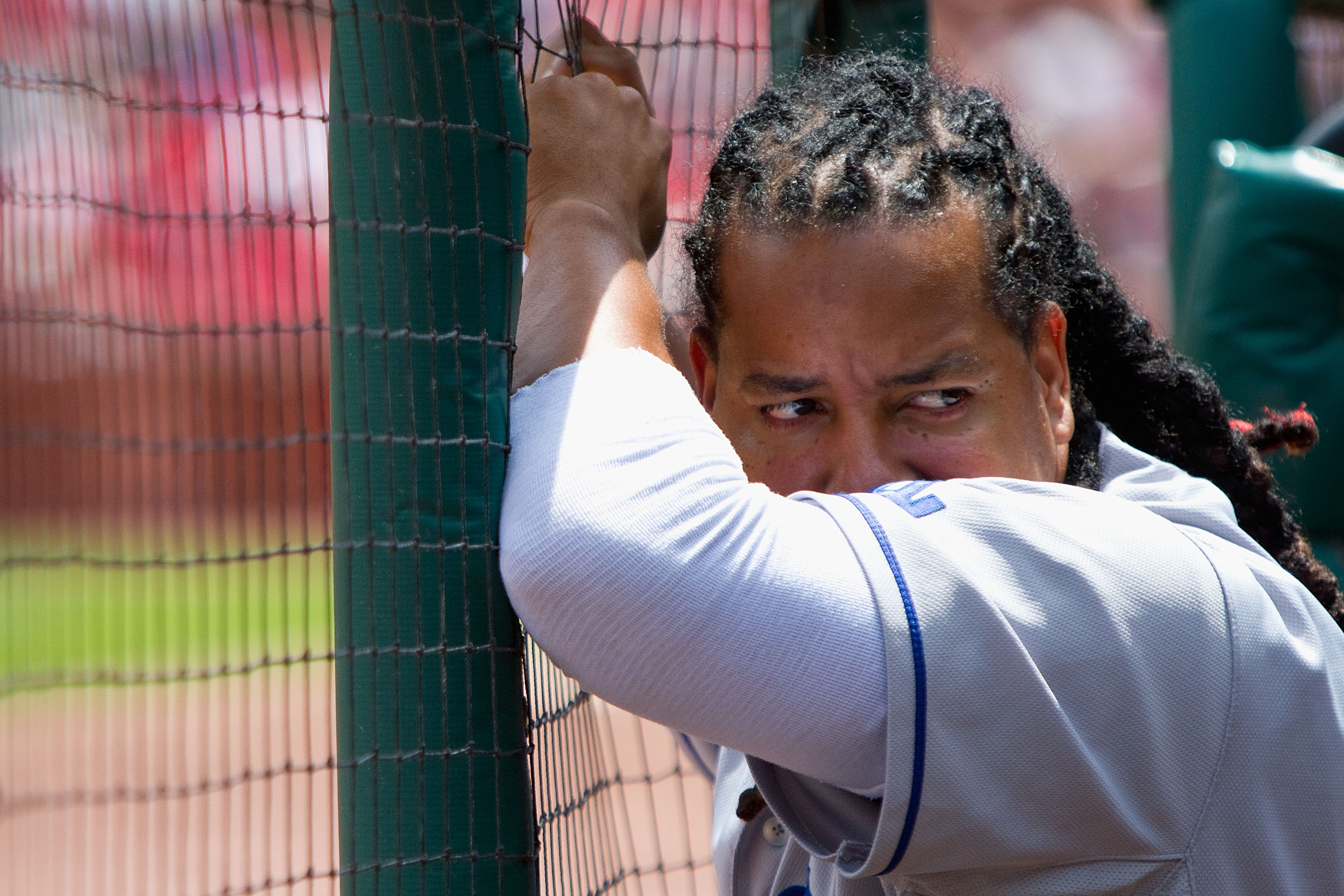 ST. LOUIS - JULY 18: Manny Ramirez #99 of the Los Angeles Dodgers looks on from the dugout against the St. Louis Cardinals at Busch Stadium on July 18, 2010 in St. Louis, Missouri.  The Cardinals beat the Dodgers 5-4.  (Photo by Dilip Vishwanat/Getty Imag