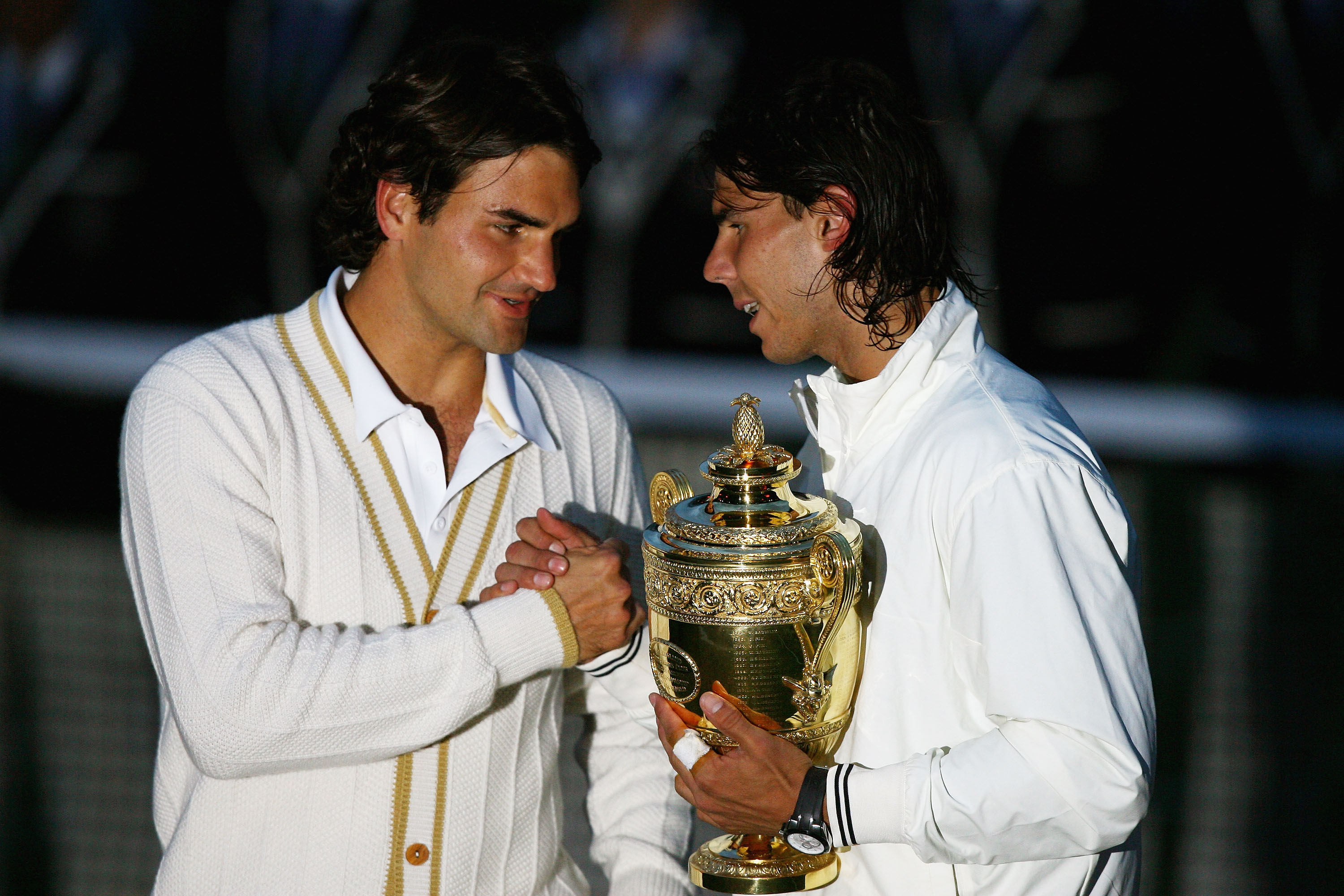 LONDON - JULY 06:  Roger Federer of Switzerland congratulates Rafael Nadal of Spain in winning the Championship trophy during the men's singles Final on day thirteen of the Wimbledon Lawn Tennis Championships at the All England Lawn Tennis and Croquet Clu