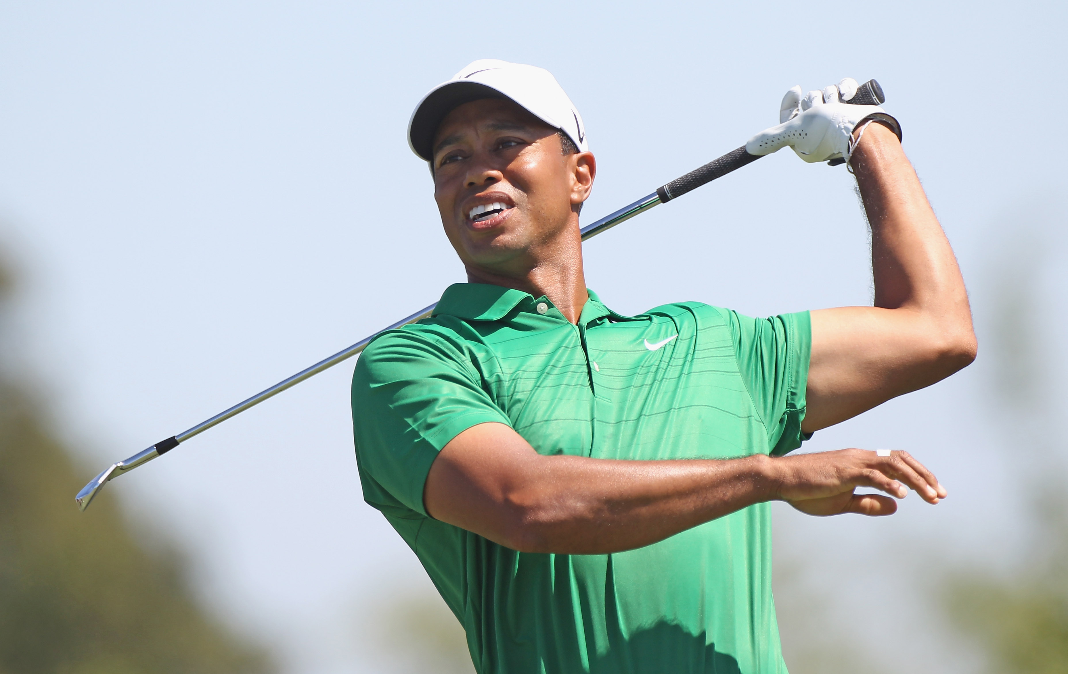 DORAL, FL - MARCH 12:  Tiger Woods reacts to a tee shot on the fourth hole hits his tee shot during the third round of the 2011 WGC- Cadillac Championship at the TPC Blue Monster at the Doral Golf Resort and Spa on March 12, 2011 in Doral, Florida.  (Phot