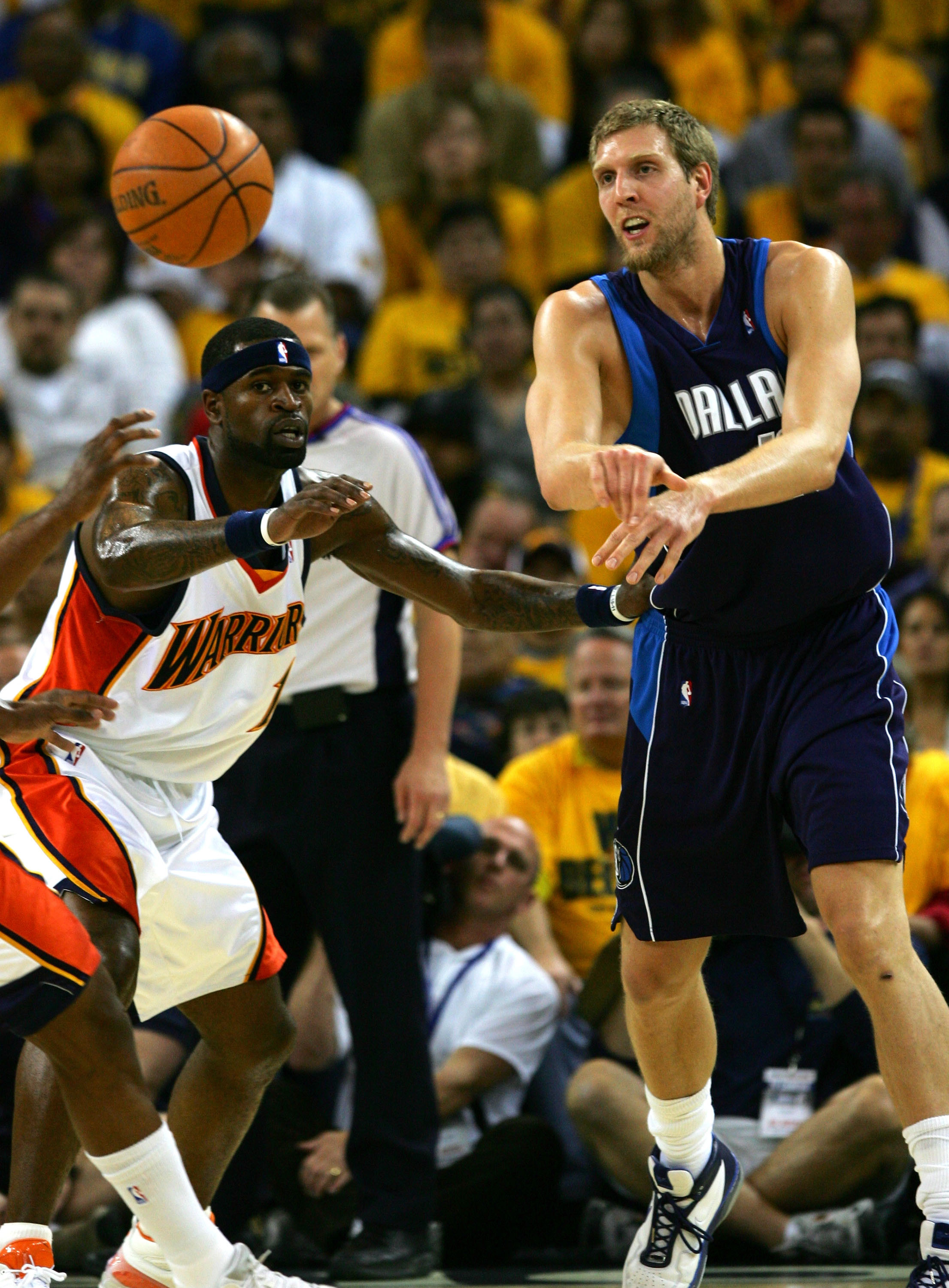 OAKLAND, CA - MAY 03: Dirk Nowitizki #41 of the Dallas Mavericks passes the ball against Stephen Jackson #1 of the Golden State Warriors in Game 6 of the Western Conference Quarterfinals during the 2007 NBA Playoffs on May 3, 2007 at Oracle Arena in Oakla