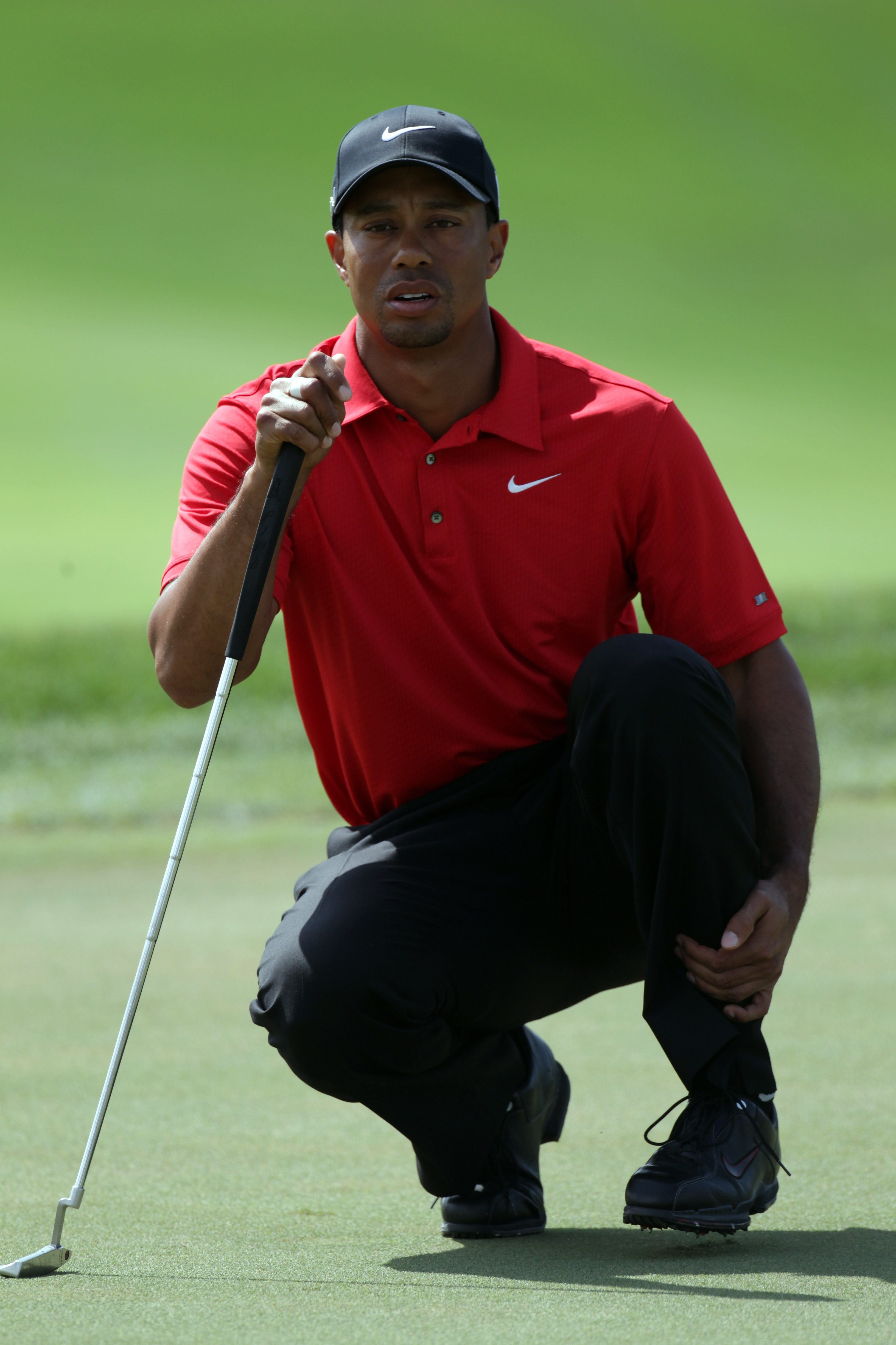 DUBAI, UNITED ARAB EMIRATES - FEBRUARY 13:  Tiger Woods of the USA during the final round of the Omega Dubai Desert Classic on the Majlis course at the Emirates Golf Club on February 13, 2011 in Dubai, United Arab Emirates.  (Photo by Ross Kinnaird/Getty