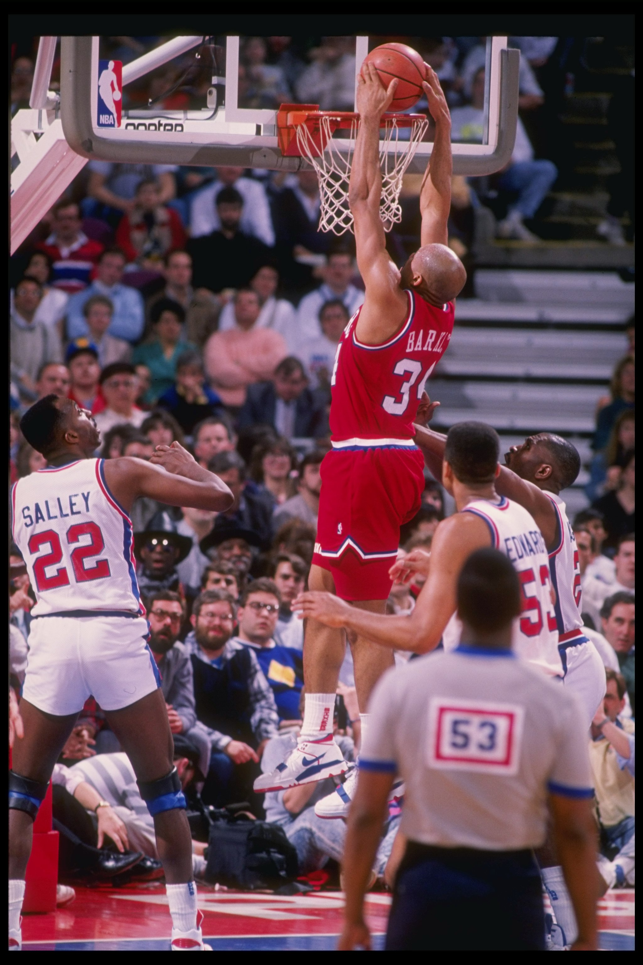 Forward Charles Barkley of the Philadelphia 76ers slam dunks during a game against the Detroit Pistons at The Palace of Auburn Hills in Auburn Hill, Michigan.