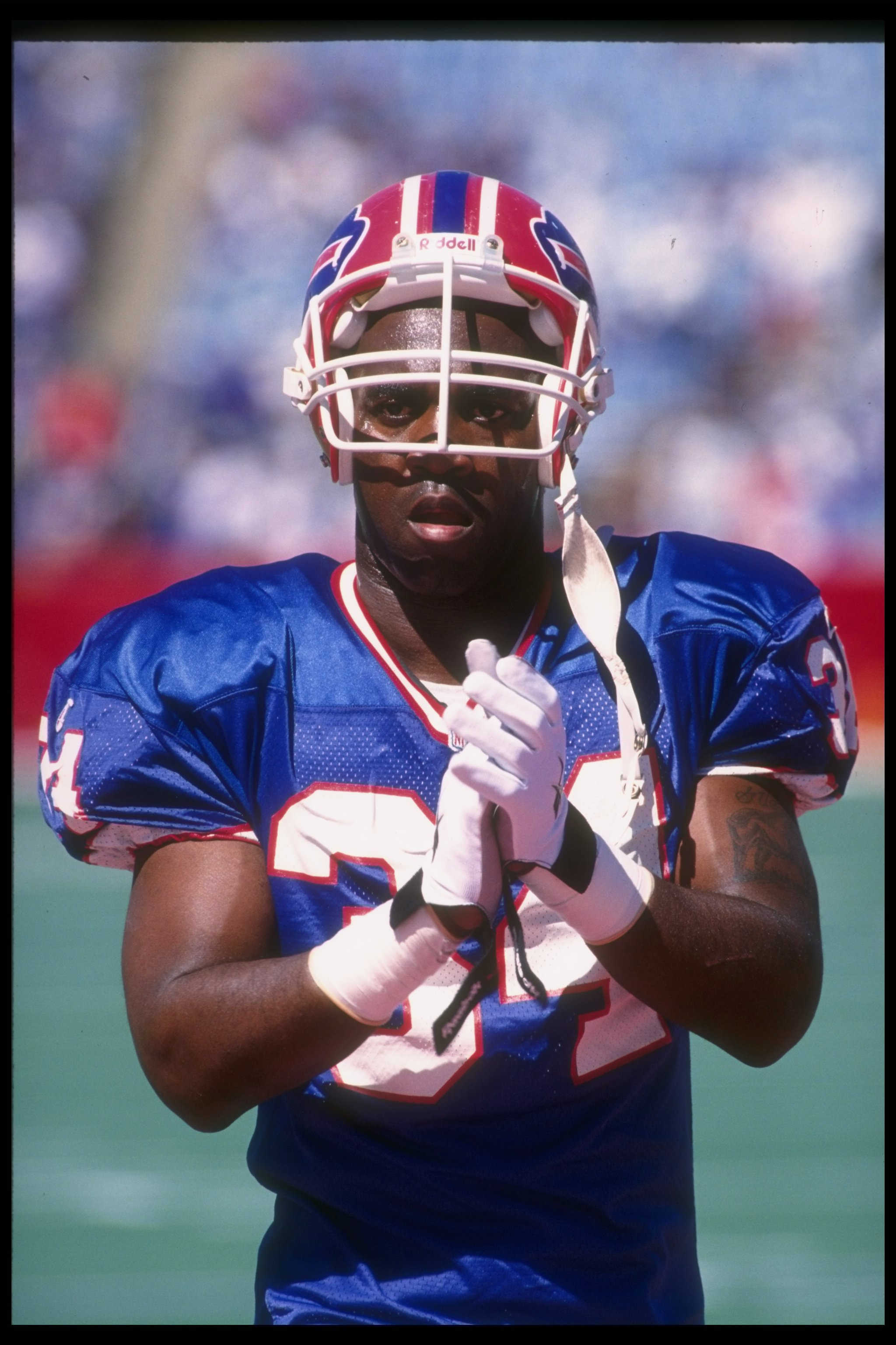 10 Sep 1995: Running back Thurman Thomas of the Buffalo Bills looks on during a game against the Carolina Panthers at Rich Stadium in Orchard Park, New York. The Bills won the game, 31-9.