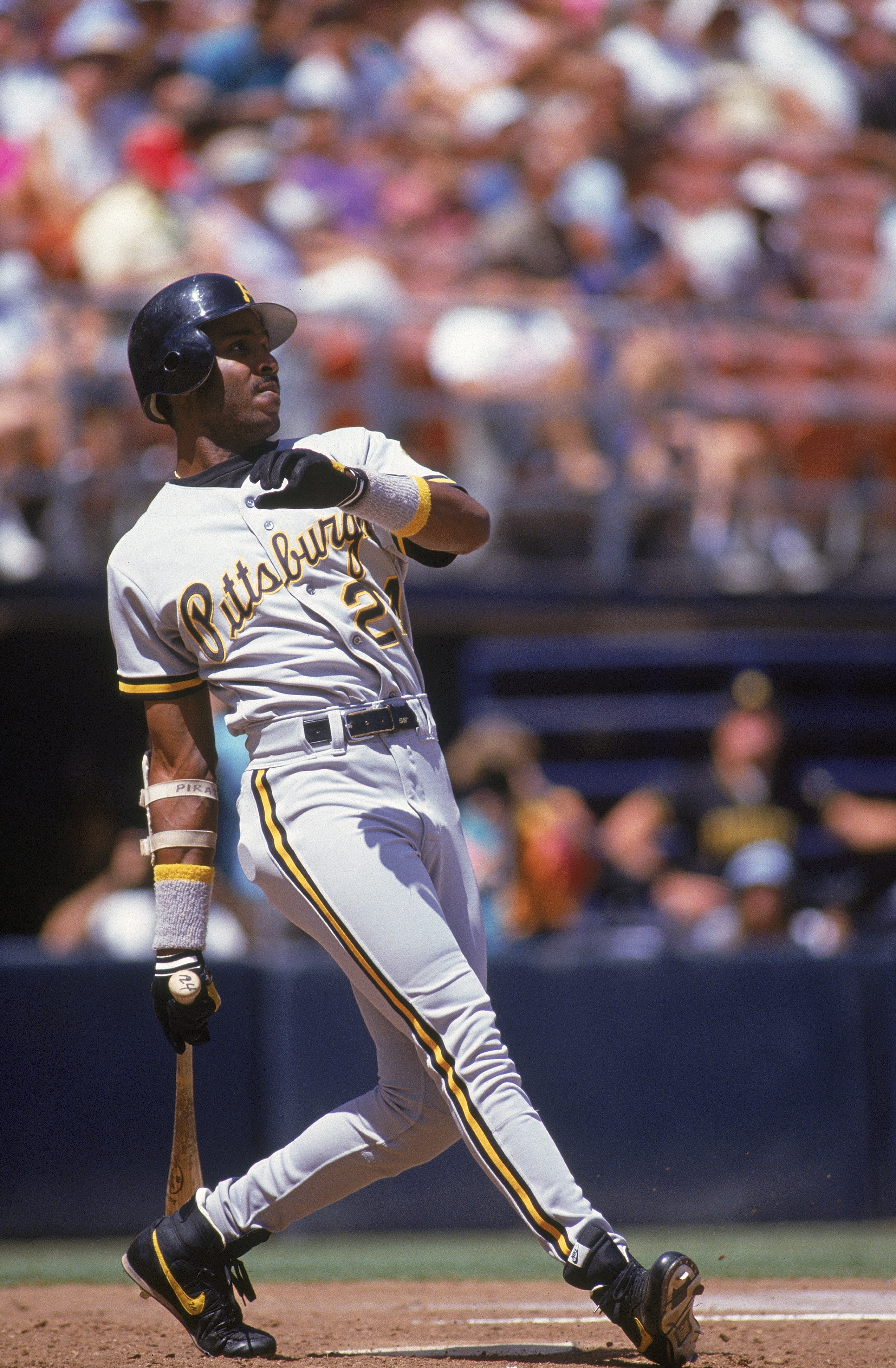 SAN DIEGO - AUGUST 30: Barry Bonds #24  of the Pittsburgh Pirates watches the flight of his hit against the San Diego Padres on August 30, 1992 at Jack Murphy Stadium in San Diego, California. Barry Bonds made his 165 career home run during this game. Bar