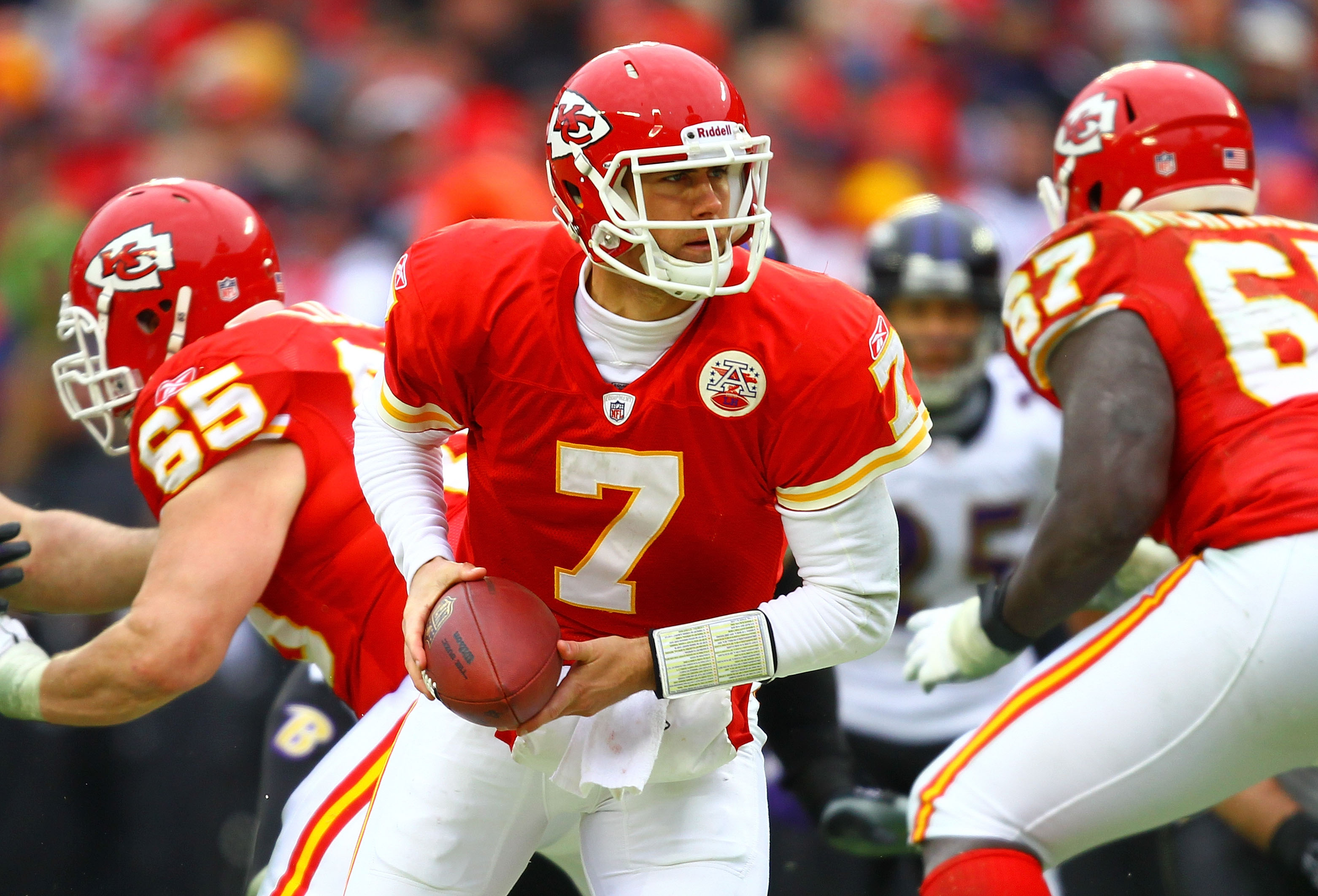 KANSAS CITY, MO - JANUARY 09:  Quarterback Matt Cassel #7 of the Kansas City Chiefs rolls out against the Baltimore Ravens in their 2011 AFC wild card playoff game at Arrowhead Stadium on January 9, 2011 in Kansas City, Missouri.  (Photo by Dilip Vishwana