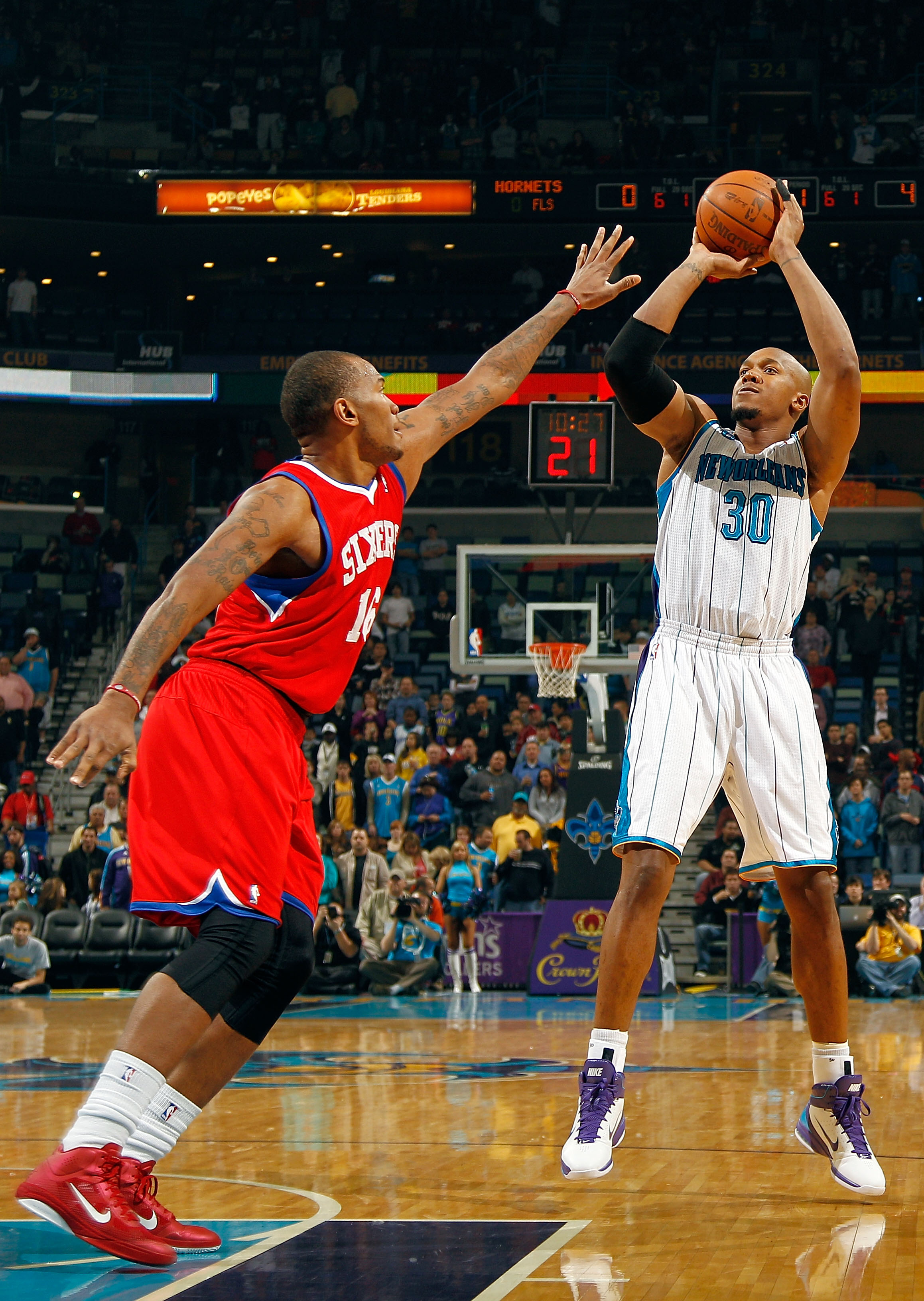 NEW ORLEANS, LA - JANUARY 03:  David West #30 of the New Orleans Hornets shoots the ball  over Marreese Speights #16 of the Philadelphia 76ers in the first half at New Orleans Arena on January 3, 2011 in New Orleans, Louisiana. NOTE TO USER: User expressl
