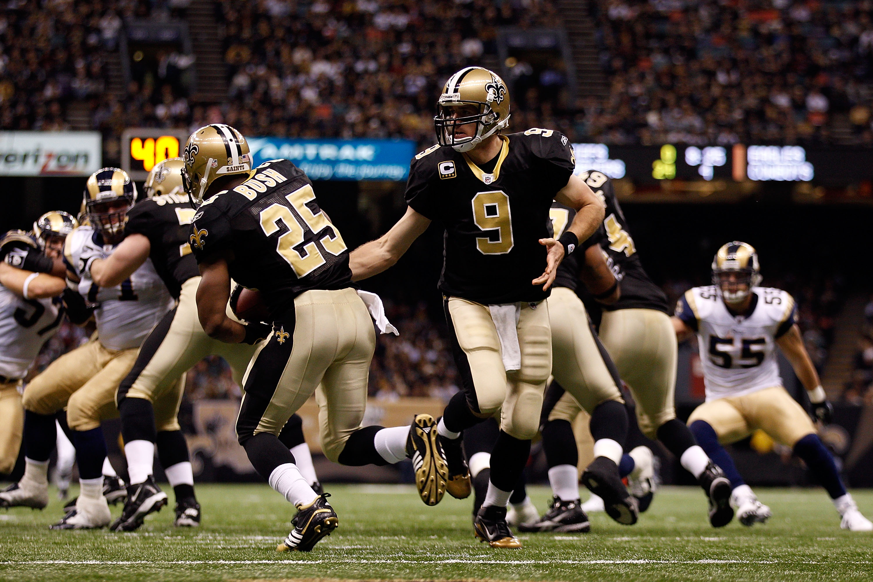 NEW ORLEANS, LA - DECEMBER 12:  Drew Brees #9 hands the ball off to Reggie Bush #25 of the New Orleans Saints during the game against the St. Louis Rams at the Louisiana Superdome on December 12, 2010 in New Orleans, Louisiana. The Saints defeated the Ram