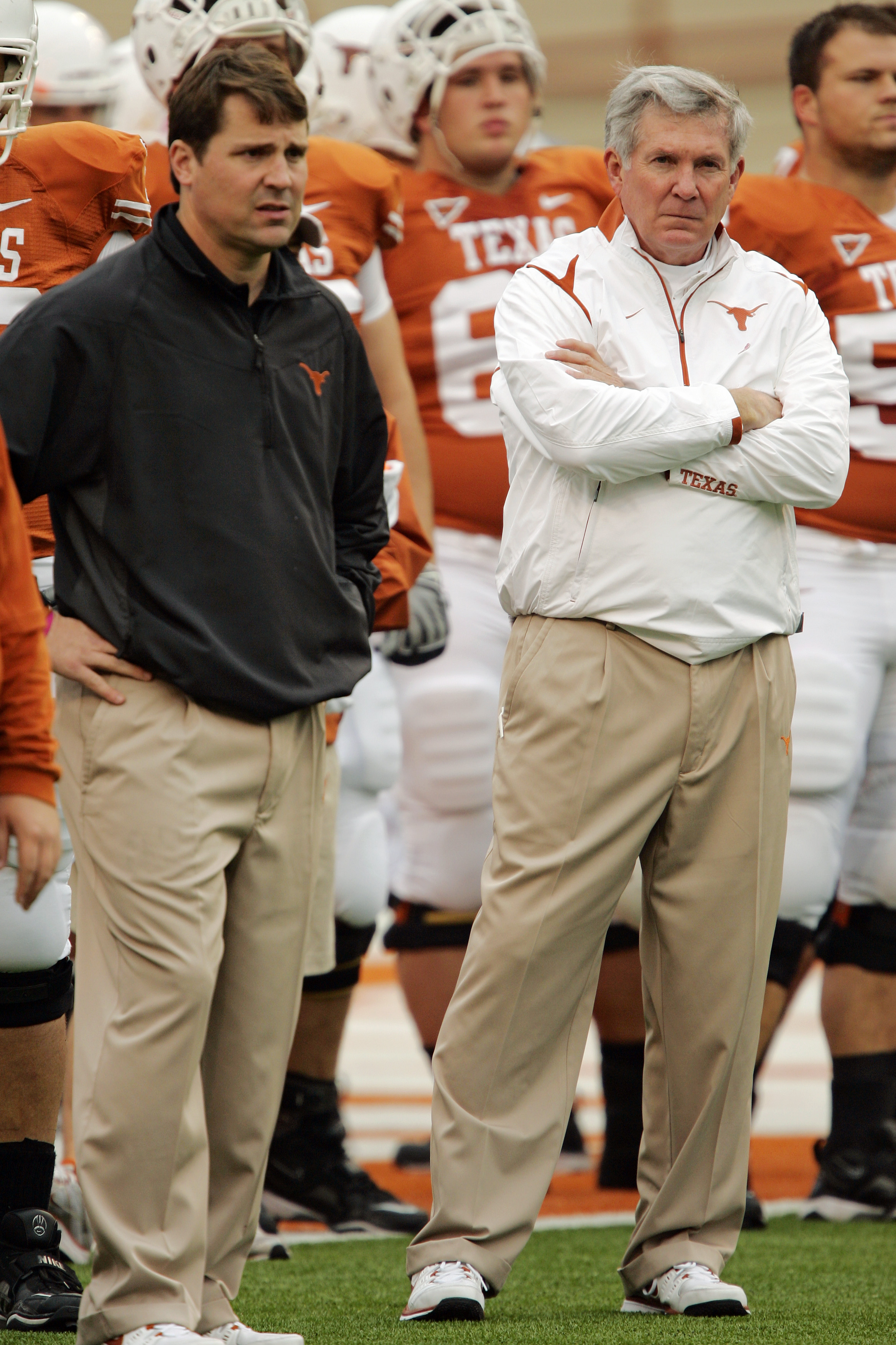AUSTIN, TX - OCTOBER 10: Defensive coordinator Will Muschamp and head coach Mack Brown of the Texas Longhorns lead their team in pregame drills before playing the Colorado Buffaloes on October 10, 2009 at the Darrell K Royal-Texas Memorial Stadium in Aust