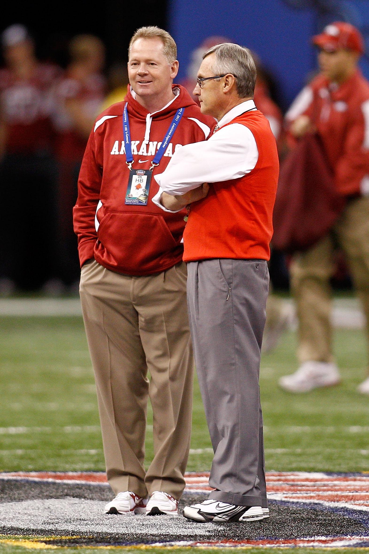 NEW ORLEANS, LA - JANUARY 04:  (L-R) Head coach Bobby Petrino of the Arkansas Razorbacks talks with head coach Jim Tressel of the Ohio State Buckeyes before the Allstate Sugar Bowl at the Louisiana Superdome on January 4, 2011 in New Orleans, Louisiana.