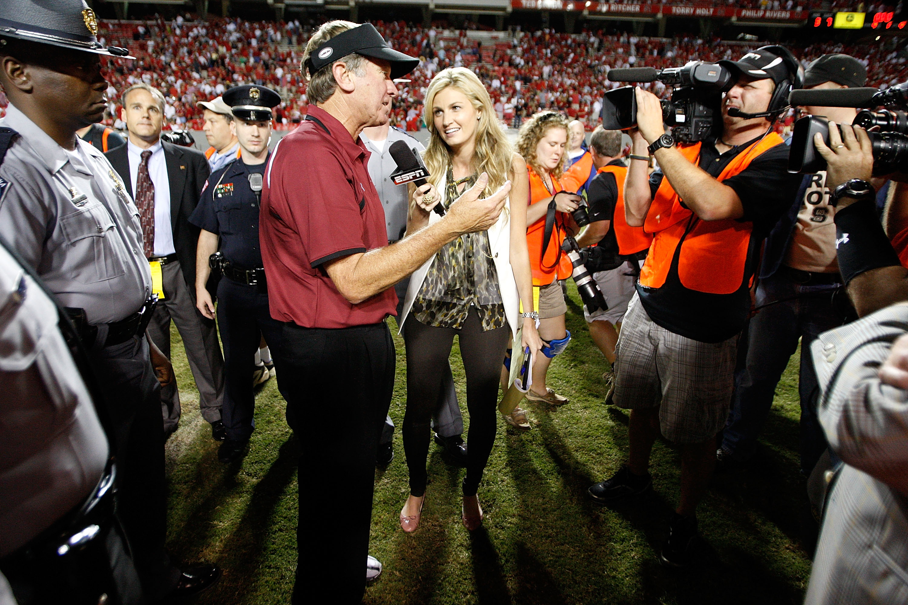 RALEIGH, NC - SEPTEMBER 3:  ESPN sideline reporter Erin Andrews interviews head coach Steve Spurrier of the South Carolina Gamecocks after their game against the North Carolina State Wolfpack at Carter-Finley Stadium on September 3, 2009 in Raleigh, North