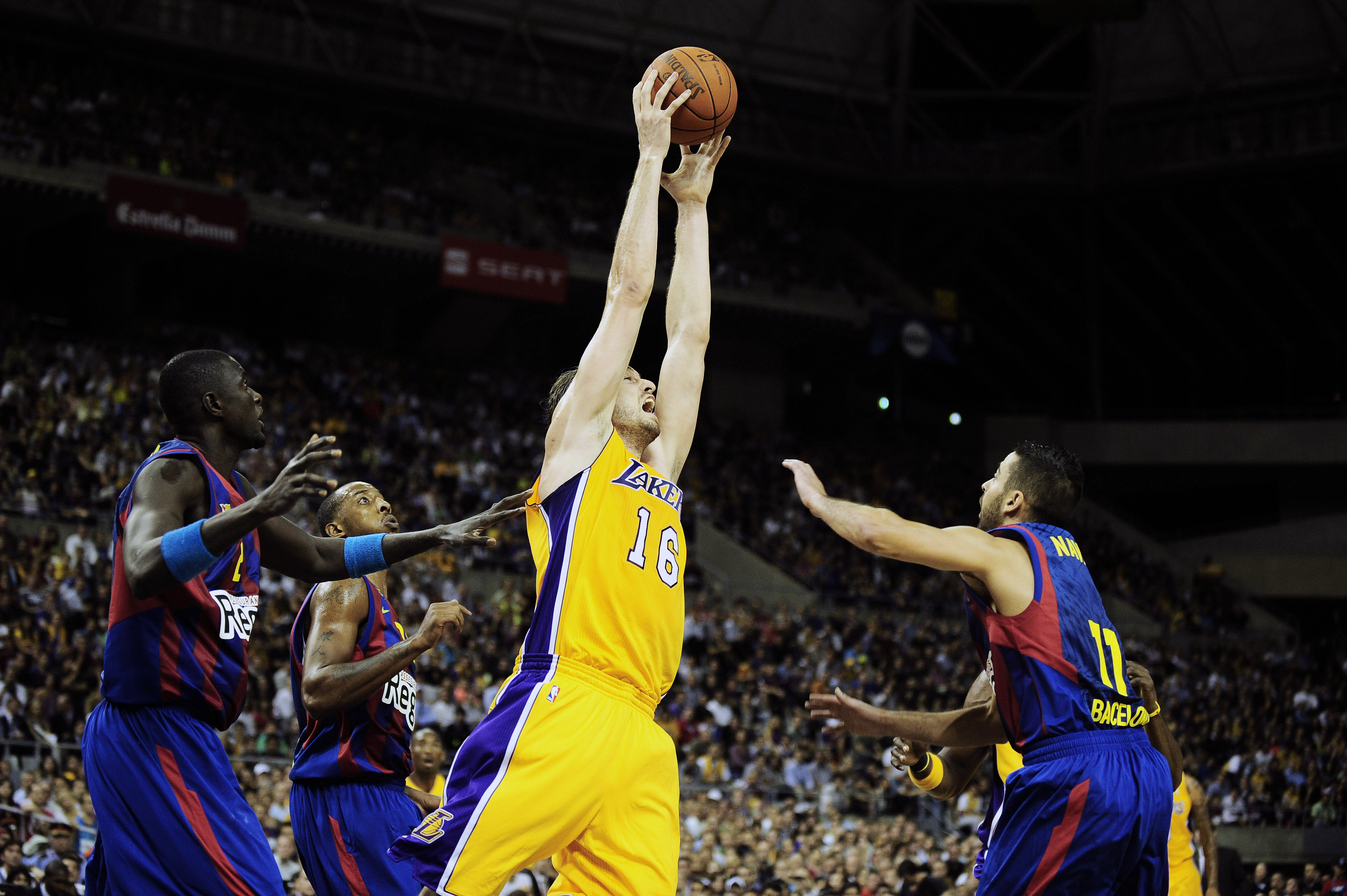 BARCELONA, SPAIN - OCTOBER 07:  Pau Gasol #16 of the Los Angeles Lakers (3rdL) fights for a rebound against Boniface Ndong #21 of the Regal FC Barcelona (L), Terence Morris #23 of the Regal FC Barcelona (2ndL) and Juan Carlos Navarro #11 of the Regal FC B