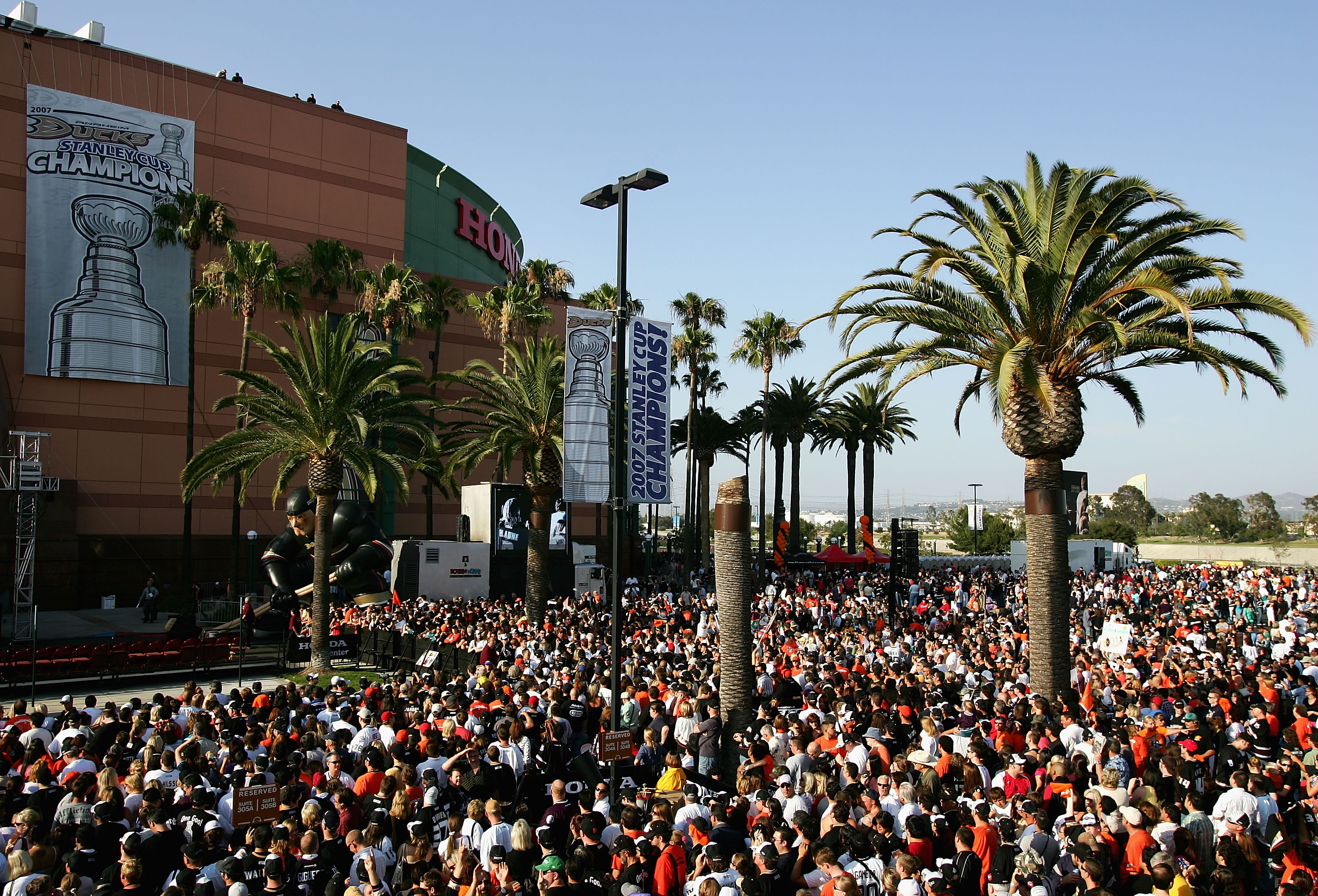 ANAHEIM, CA - JUNE 9:  Fans gather outside of the Honda Center to celebrate the Anaheim Ducks winning the 2007 Stanley Cup June 9, 2007 in Anaheim, California. (Photo by Harry How/Getty Images)