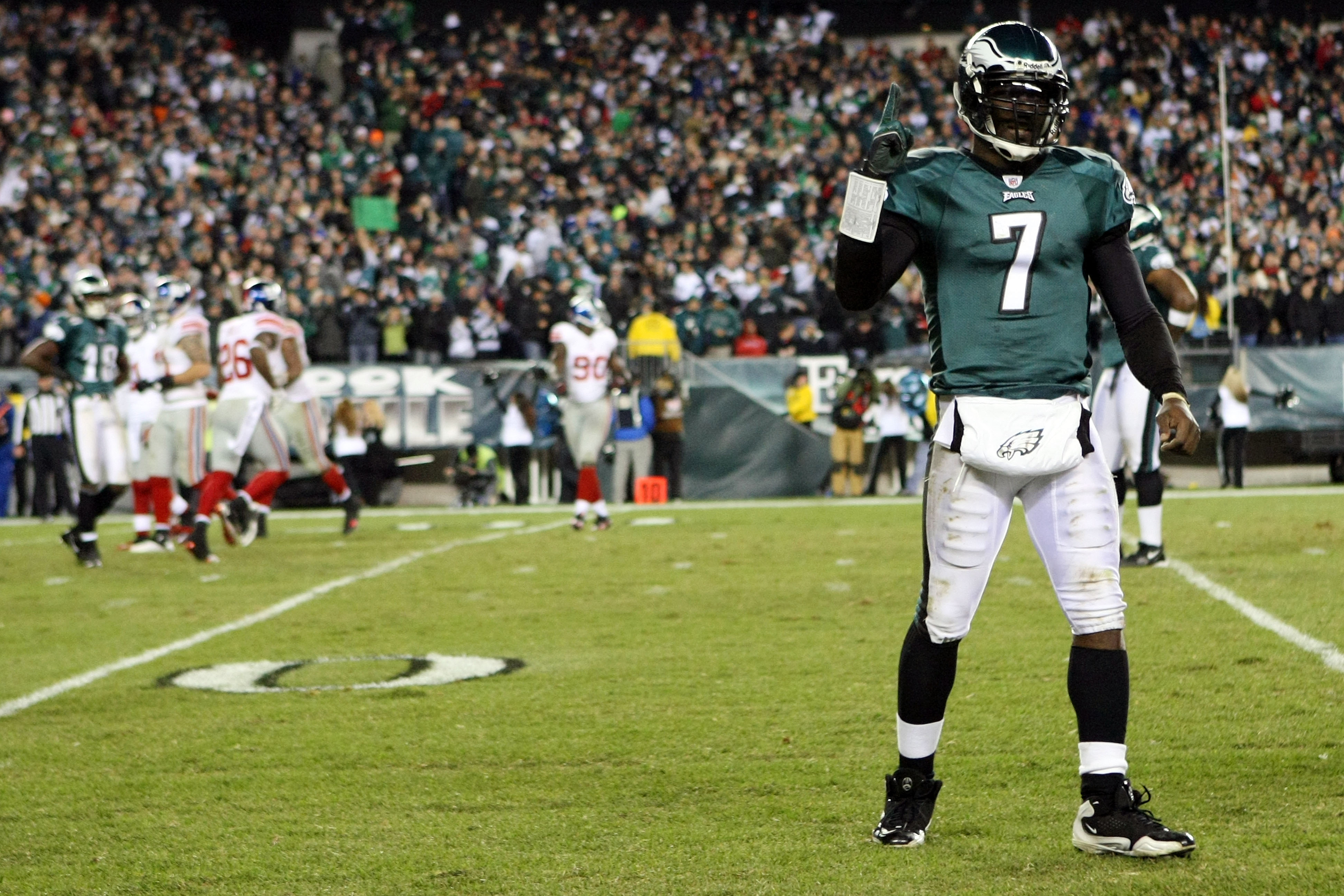 PHILADELPHIA - NOVEMBER 21:  Michael Vick #7 of the Philadelphia Eagles celebrates after converting on a two point conversion in the fourth quarter as Justin Tuck #91 of the New York Giants looks on at Lincoln Financial Field on November 21, 2010 in Phila