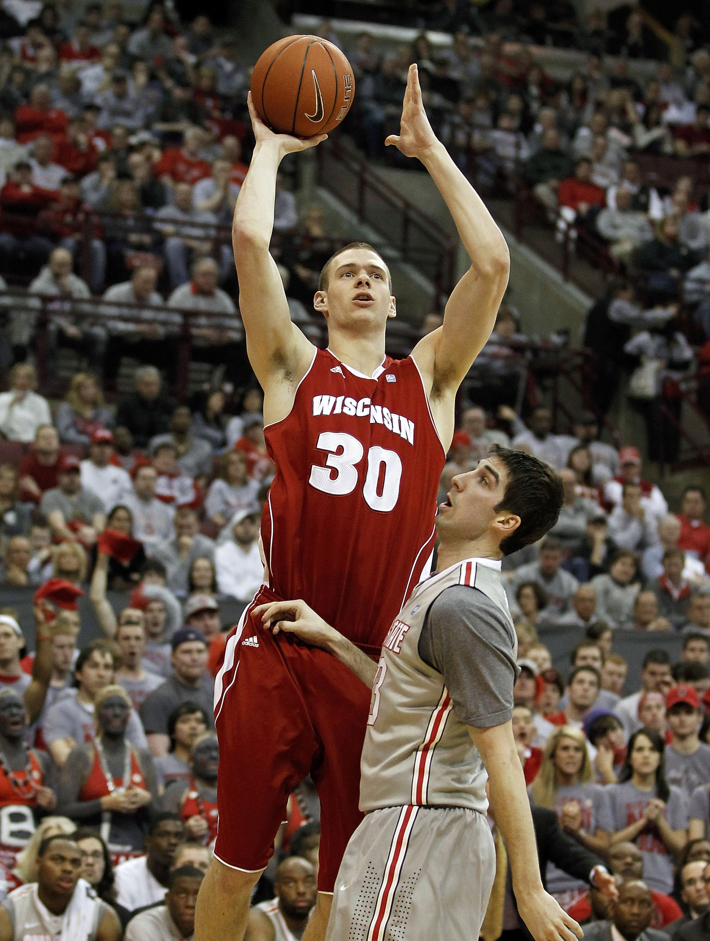 COLUMBUS, OH - MARCH 06:  Jon Leuer #30 of the Wisconsin Badgers shoots over Jon Diebler #33 of the Ohio State Buckeyeson March 6, 2011 at the Value City Arena in Columbus, Ohio.  (Photo by Gregory Shamus/Getty Images)