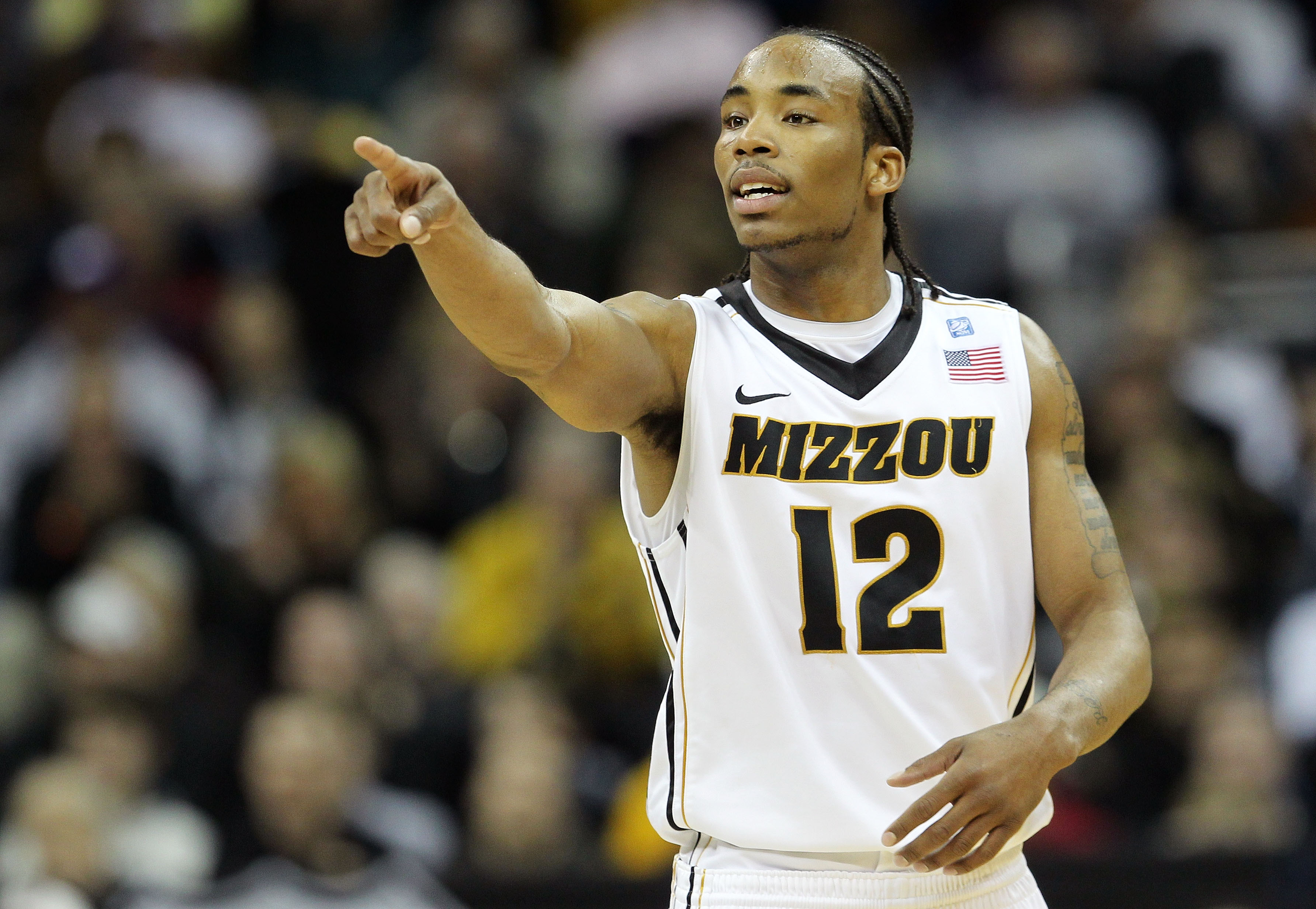 KANSAS CITY, MO - MARCH 09:  Marcus Denmon #12 of the Missouri Tigers signals against the Texas Tech Red Raiders during their first round game in the 2011 Phillips 66 Big 12 Men's Basketball Tournament at Sprint Center on March 9, 2011 in Kansas City, Mis